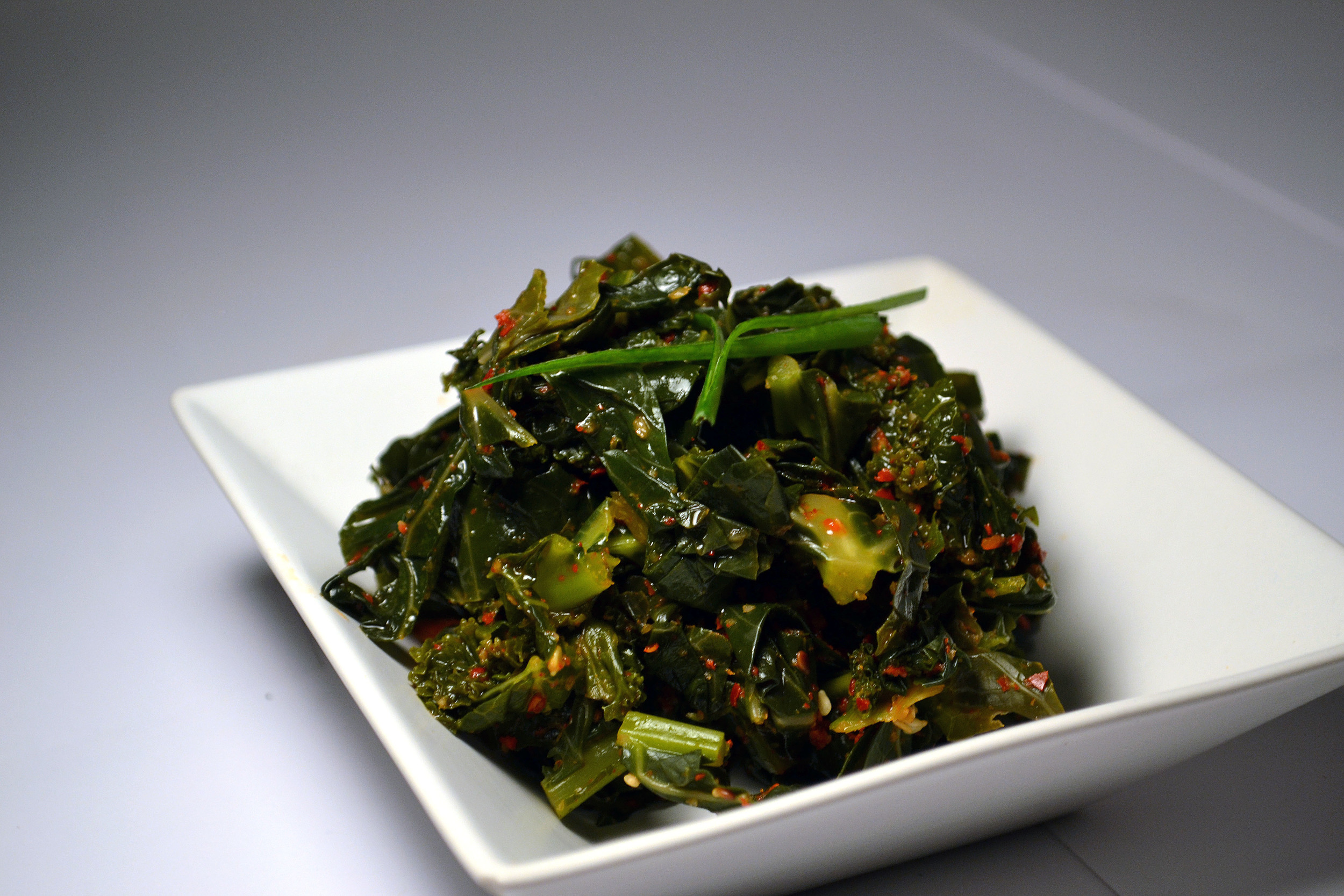 KALE KIMCHI:One of the densest and nutrient packed vegetables, Kale Kimchi is a super food. We pulverize the hard middle stem and mix it in the sauce, to make sure you get your fiber!