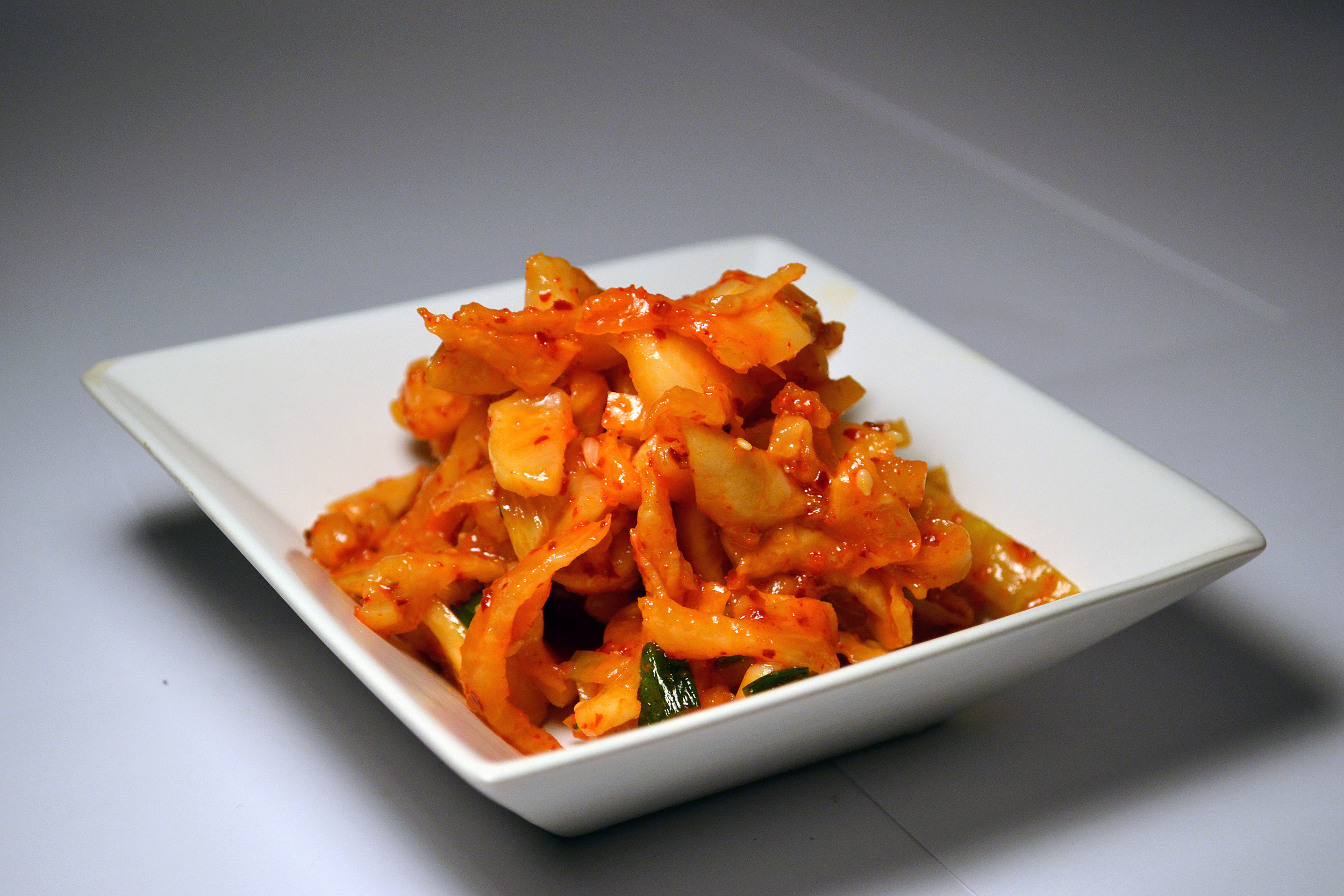 DAIKON MOOCHIM:A drier Kimchi, the Daikon radish is fermented for a month before hand, then turned into Kimchi. Made differently from the other Daikon varieties, but just as crunchy and rich in flavor!