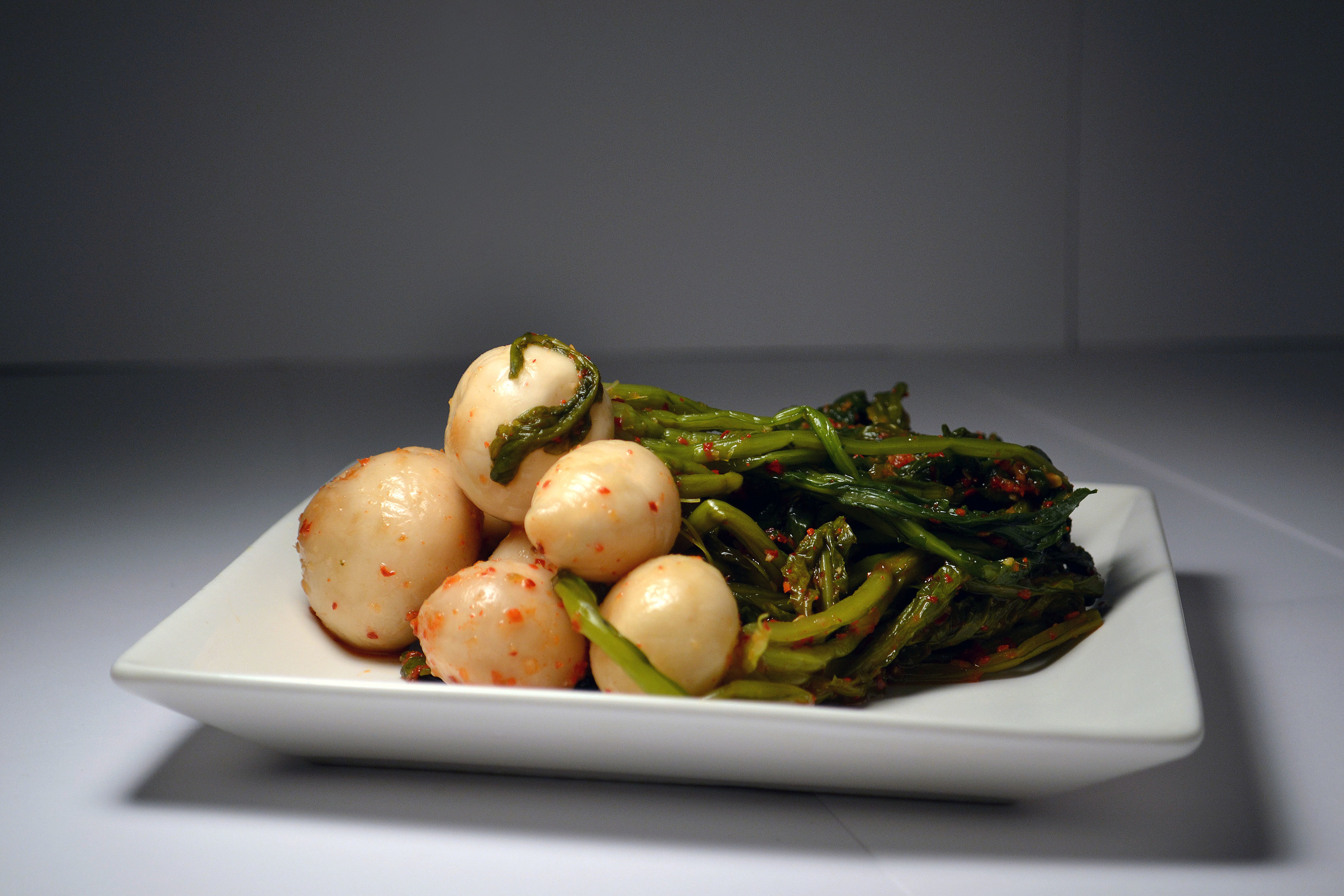 TURNIP KIMCHI:Like the Daikon Kimchi, the turnip is crunchy and tangy in taste. Natural and wholesome, the Turnip Kimchi will give you the nutrients and flavor desired.