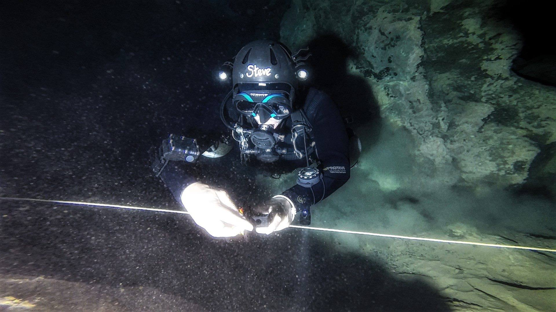 The Author laying a line while cave diving -Cueva Del Agua, Spain. Photo credit  Tom Steiner