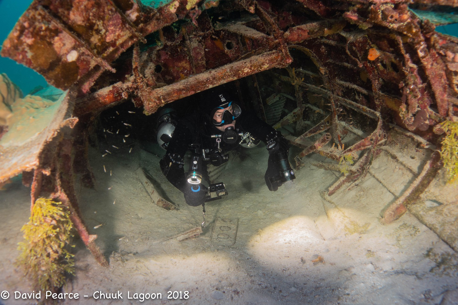 Exiting the Fuselage of Betty Bomber, Truk Lagoon