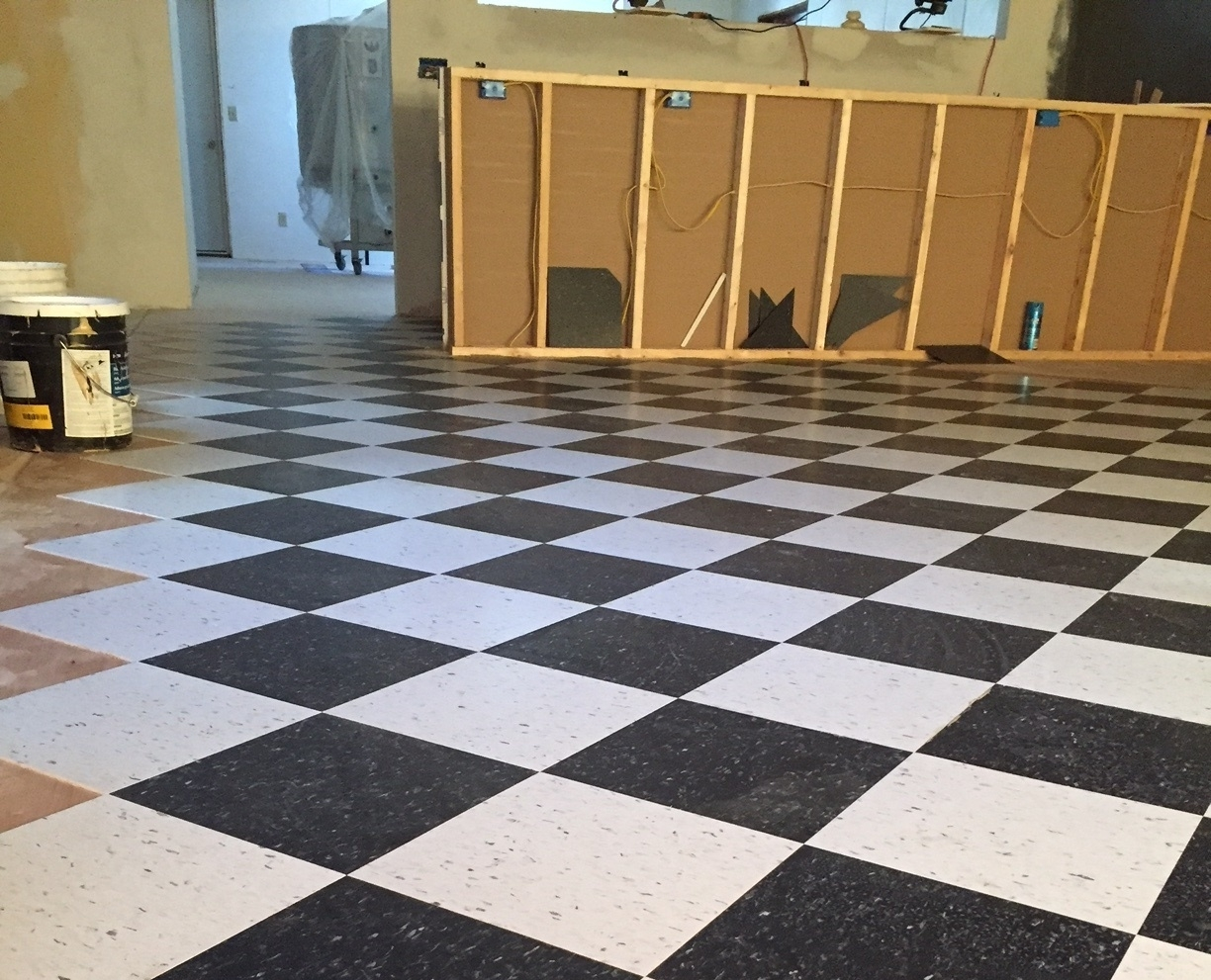 We decided to go with black and white tile and had Hardy Builders install it (in a diamond pattern of course!)