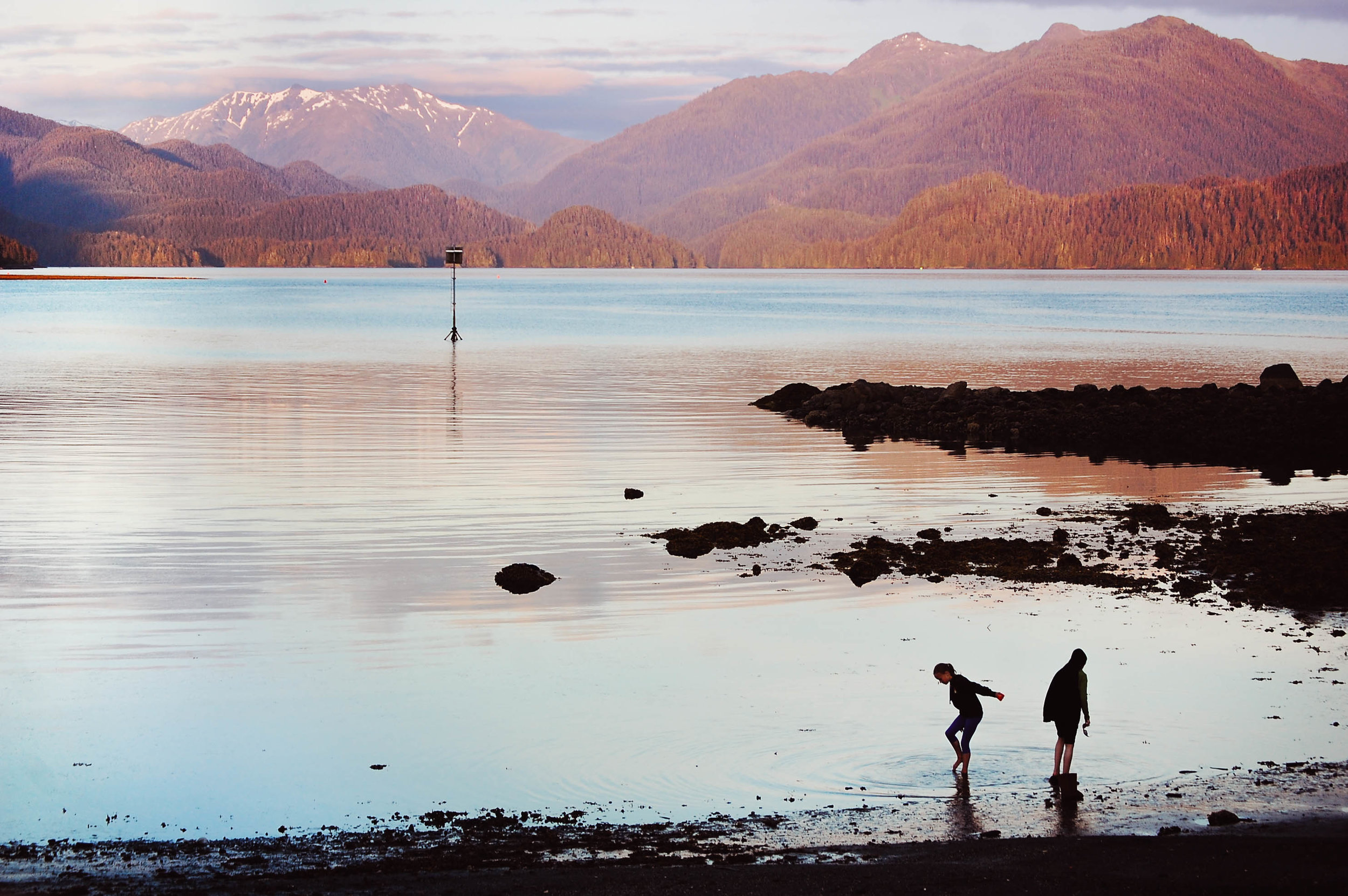 Children play on the beach in Sitka on the summer solstice