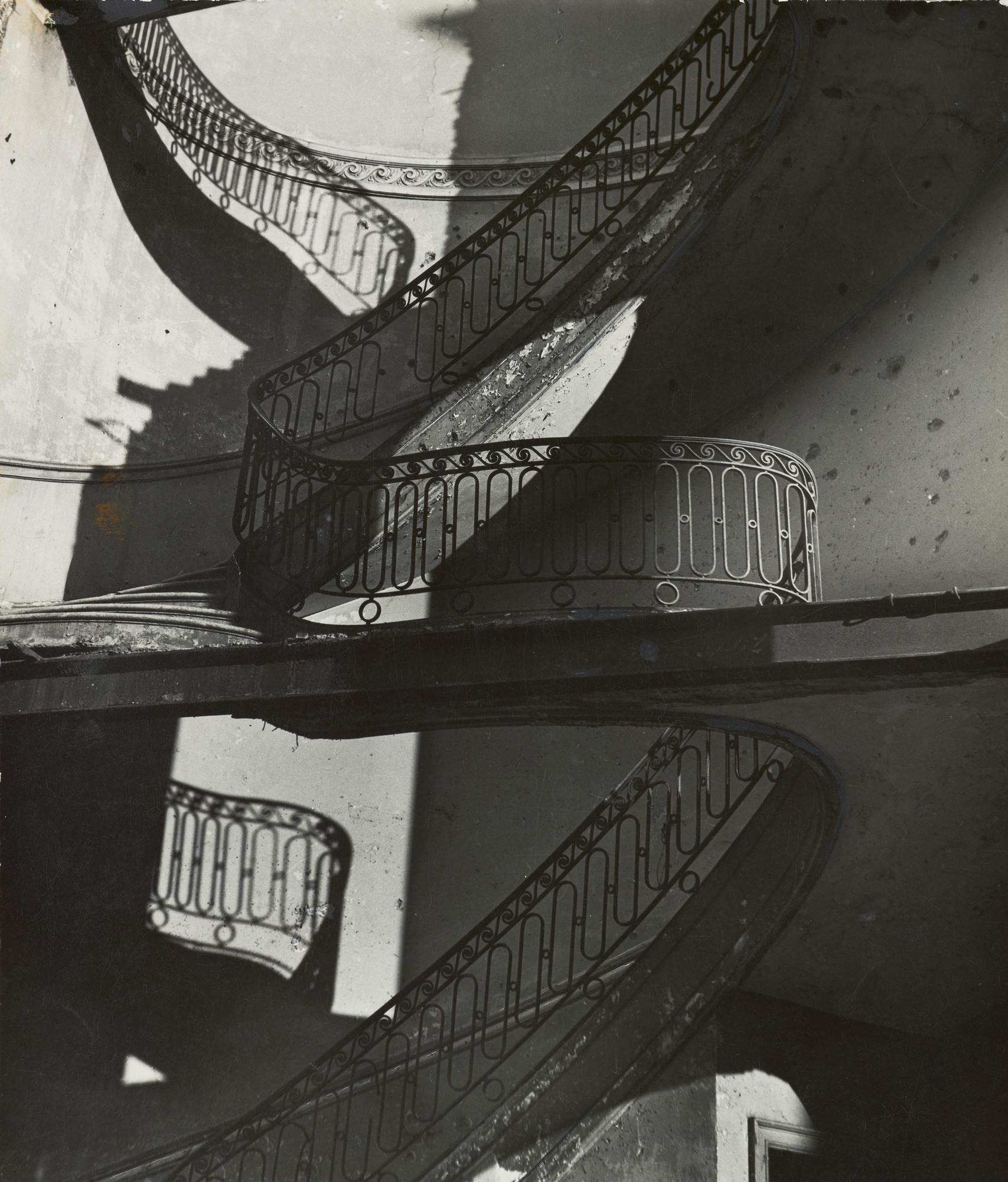 "Bill Brandt.  Bombed Regency Staircase, Upper Brook Street, Mayfair  detail. c. 1942. Gelatin silver print, 9 x 7 5/8"" (22.8 x 19.4 cm). The Museum of Modern Art, New York. Acquired through the generosity of Clarissa A. Bronfman. © 2015 Bill Brandt Archive"