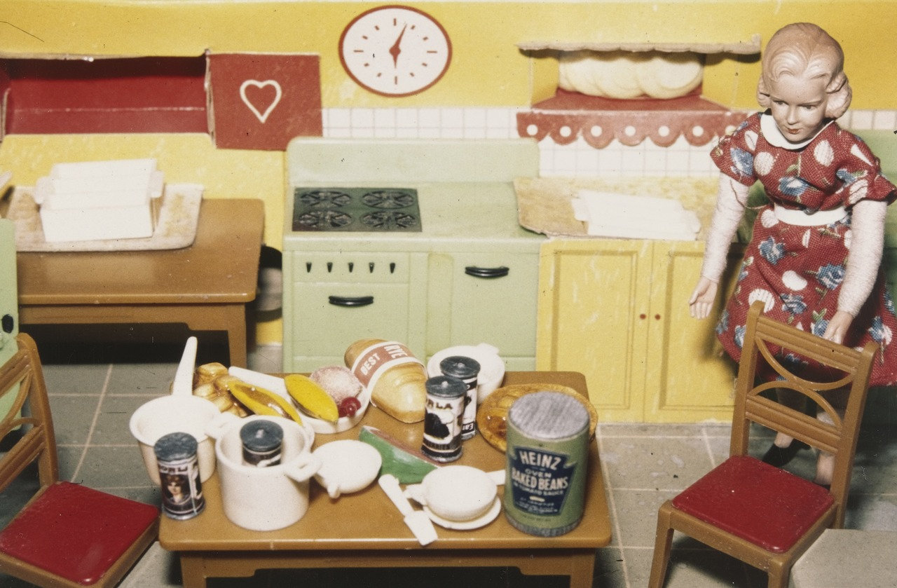"Laurie Simmons.  Blonde/Red Dress/Kitchen . 1978. Silver dye bleach print, 3 1/4 x 5"" (8.3 x 12.7 cm). The Museum of Modern Art, New York. Joel and Anne Ehrenkranz Fund. © 2016 Laurie Simmons"