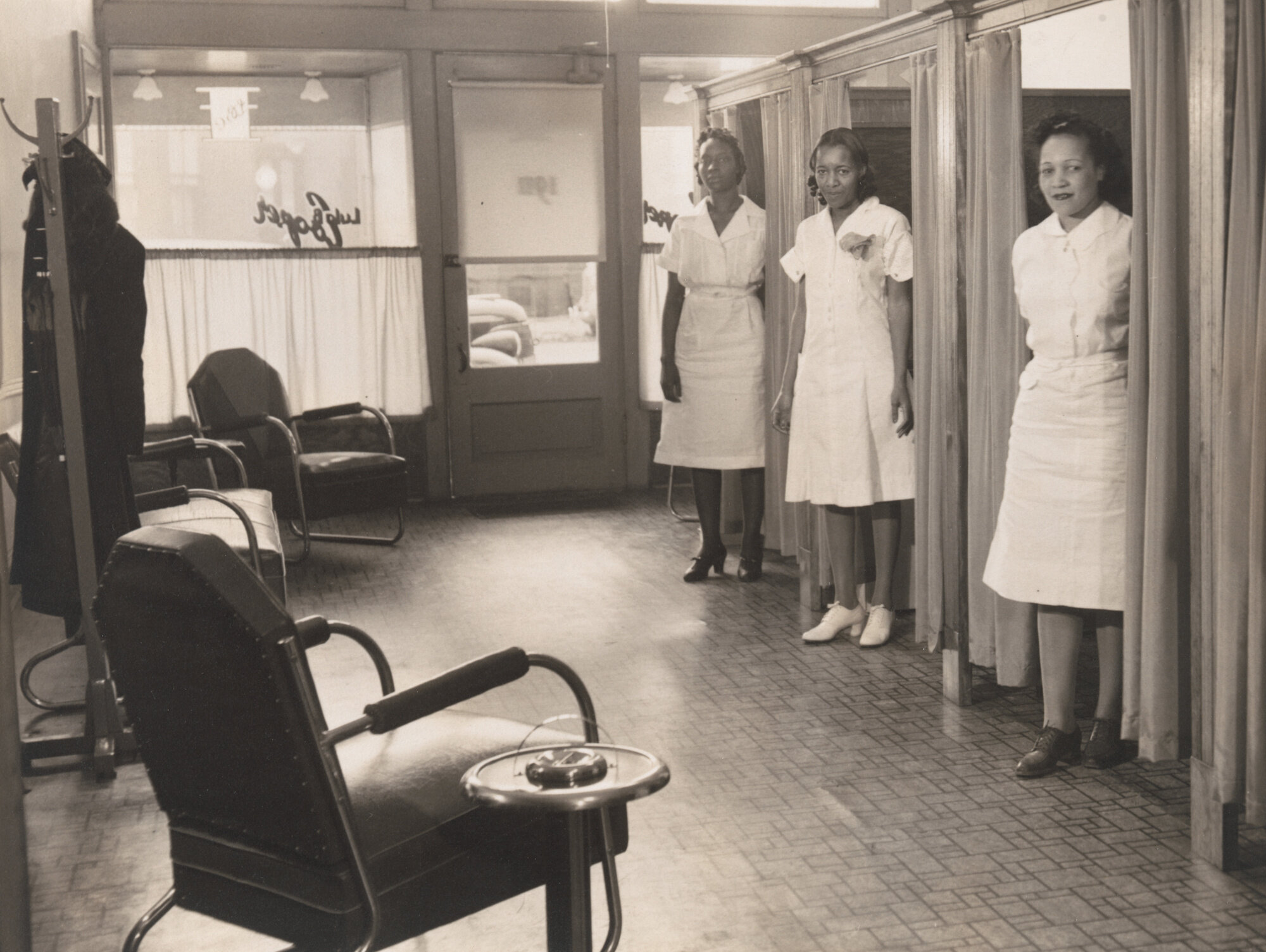 "Robert H. McNeill. Lula Cooper Beauty Salon. c. 1940. Gelatin silver print, 7 3/16 × 9 1/2"" (18.2 × 24.1 cm). Acquired through the generosity of The Friends of Education of The Museum of Modern Art and Committee on Photography Fund"