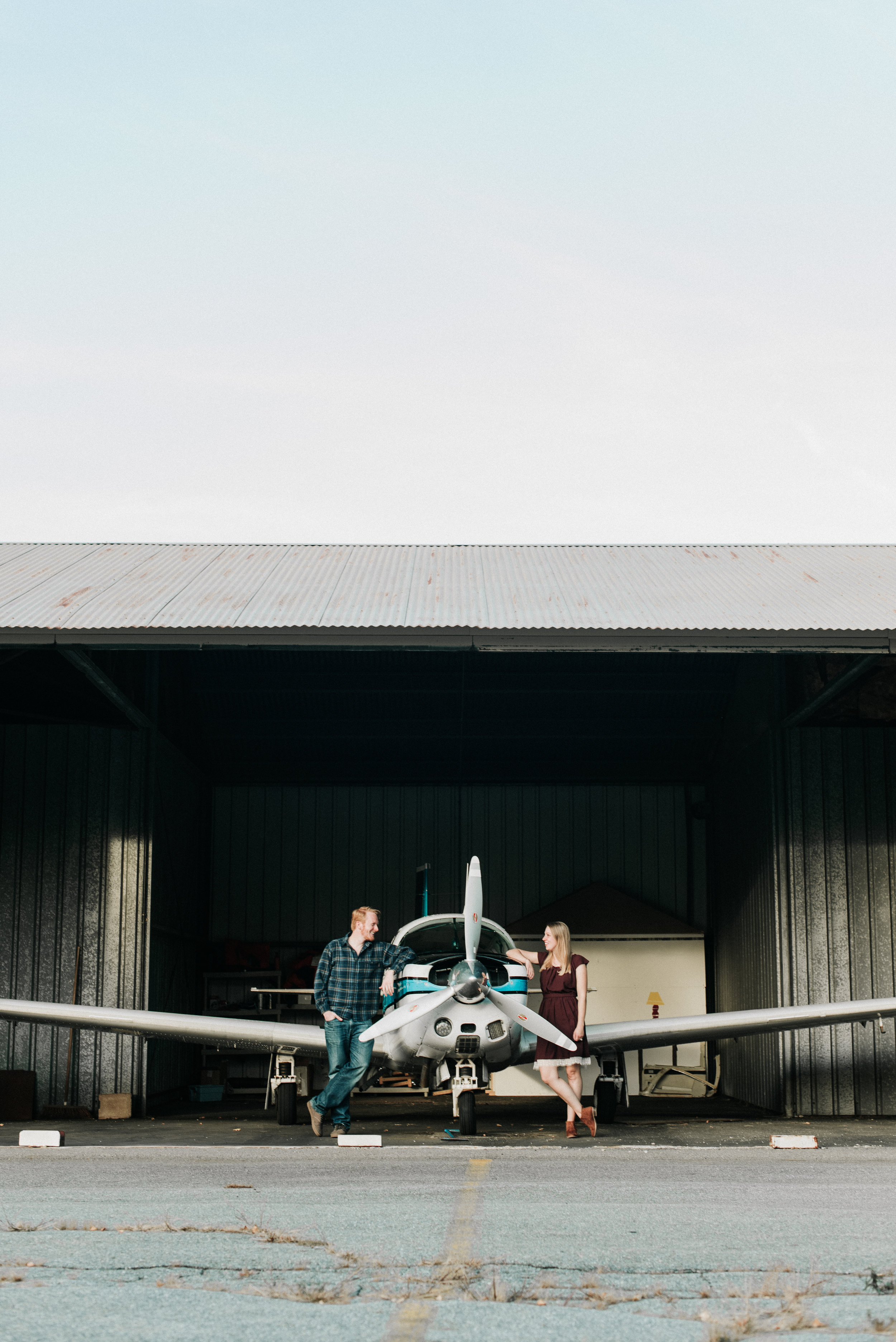 Couple Engagement photos with plane at a Boston airport