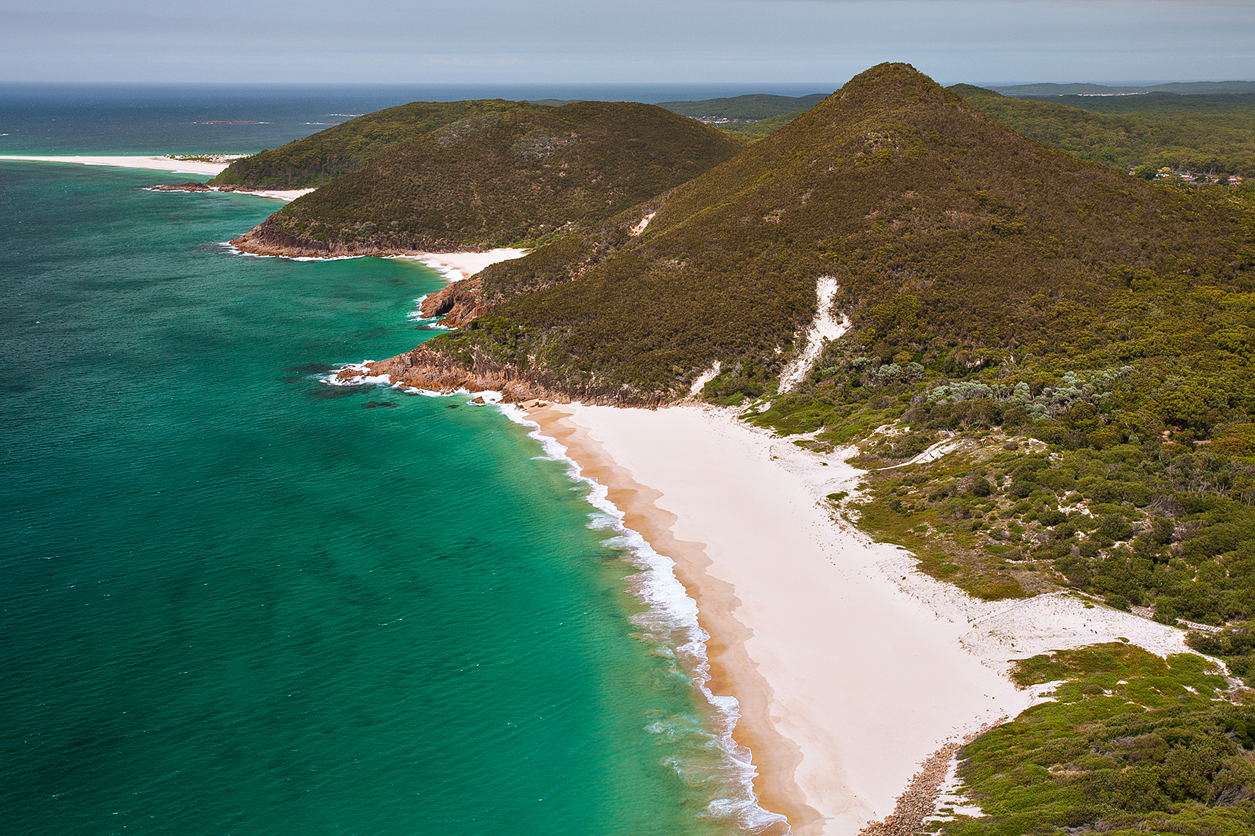 Photograph of Zenith Beach taken from the lookout at the summit of Mount Tomaree