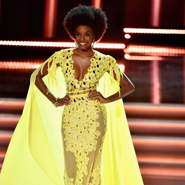"""I stand as the first Afro queen to have made it thus far."" At the 2017 Miss Universe pageant, Miss Jamaica Davina Bennett became the talk of the night for wearing an Afro. She stood out among the sea of blown-out, straight styles you typically see on beauty queens and was celebrated across social media for proudly wearing her natural hair, especially considering how we still hear stories about women being told their curls are ""inappropriate"" at work and school. Even if Davina ultimately didn't win the crown (she was in the top three, named second runner-up), seeing her on stage wearing her Afro throughout the competition was a major win for inclusivity."