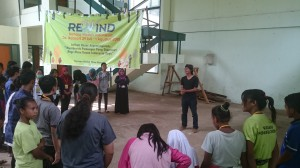 Sophan Adjie (Ophan), one of the coordinators, providing the youth some guidance during the REWIND event.