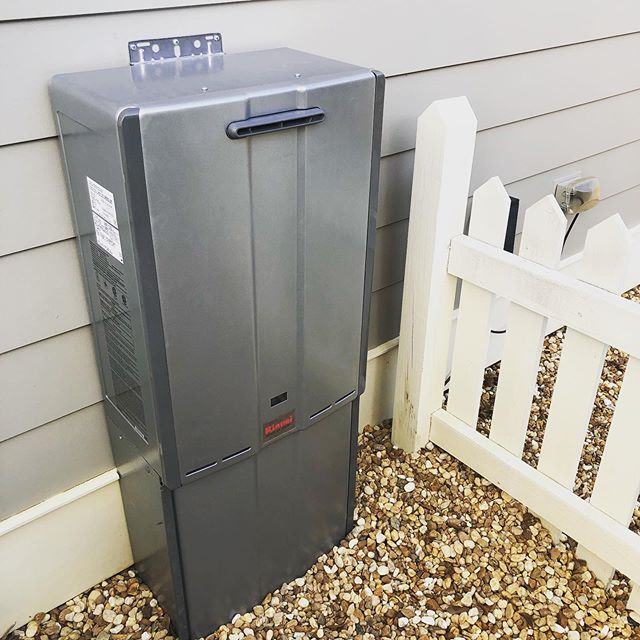 Outdoor Rinnai tankless water heater with full recirculating system packaged in one clean unit, all controlled from a smart phone or your smart home assistant! #plumbing #hightech #highefficiency #welcometothefuture #weloveourjob