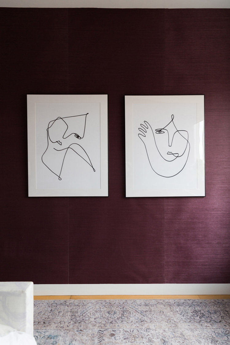 A pair of line drawings by Femme Colaris for Artfully Walls complete the space.