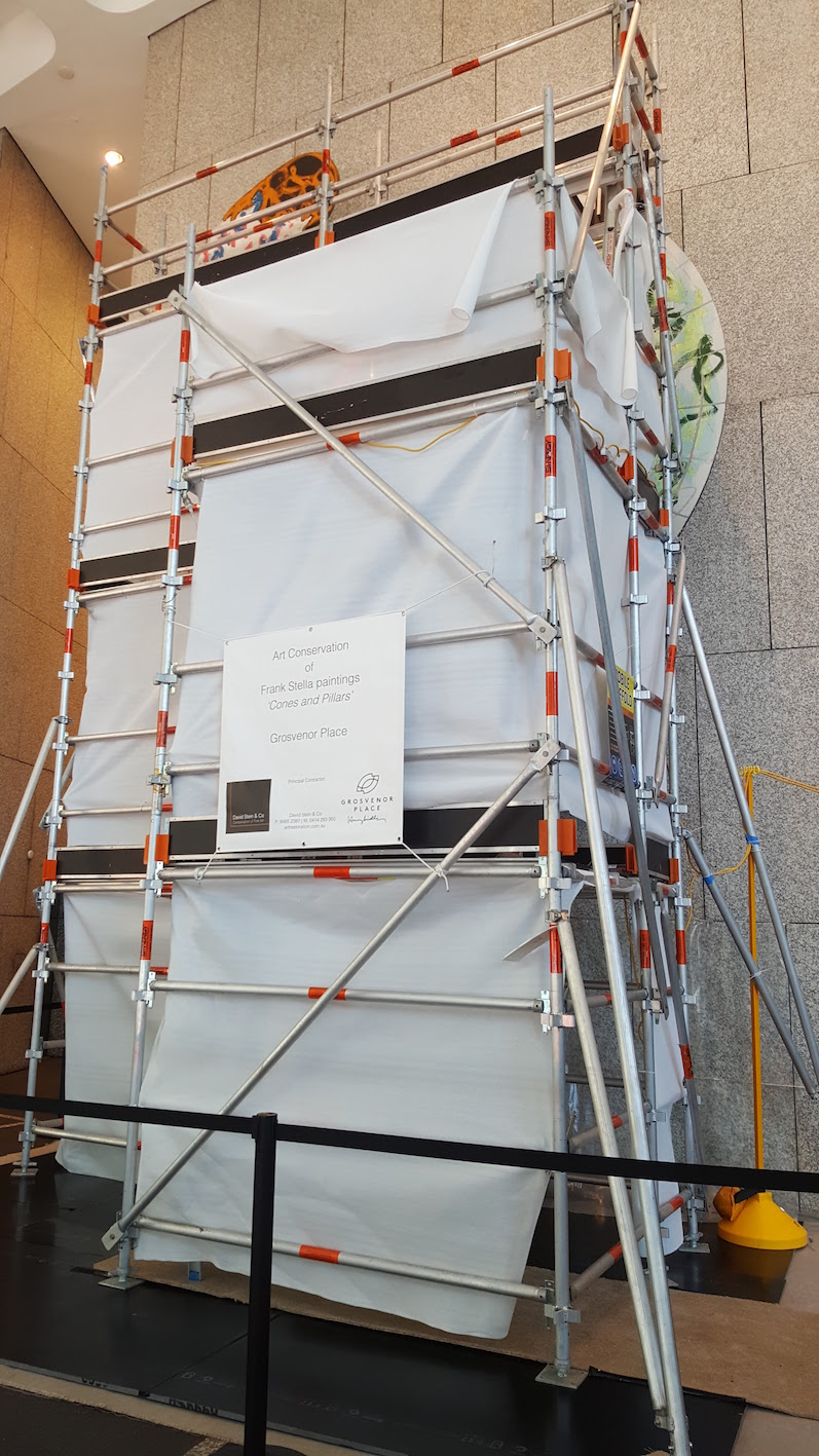 Scaffold construction to access the 7m high paintings
