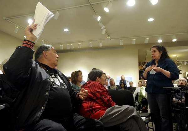 Adrienne Fritze (right) confronts Clyde Bellecourt (left) about the occupation night of Wounded Knee '73 during a presentation Friday April 27, 2012 in the Center for Western Studies at Augustana College. Photo by Jay Pickthorn - Sioux Falls  Argus Leader