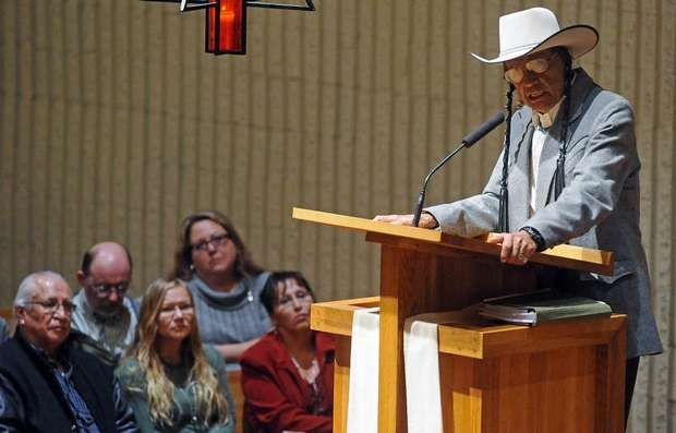 """Russell Means, former leader of the AIM (American Indian Movement) speaks Friday night at Augustana College in Sioux Falls, S.D. April 27, 2012. Means spoke as part of a two day conference at the college titled, """"Wounded Knee 1973: Forty Years Later."""" Photo by Elisha Page for the Sioux Falls  Argus Leader"""