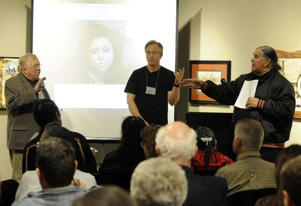 Clyde Bellecourt (right) lashes out at former FBI special agent Joseph Trimbach (not pictured)during a conference at the Center for Western Studies at Augustana College on Friday, April 27, 2012, after John Trimbach's speech about what he called a hidden side of the Wounded Knee uprising in which activists were beaten, raped, and killed. Also pictured is Lynn Aspaas (at left). Photo by Jay Pickthorn - Sioux Falls  Argus Leader