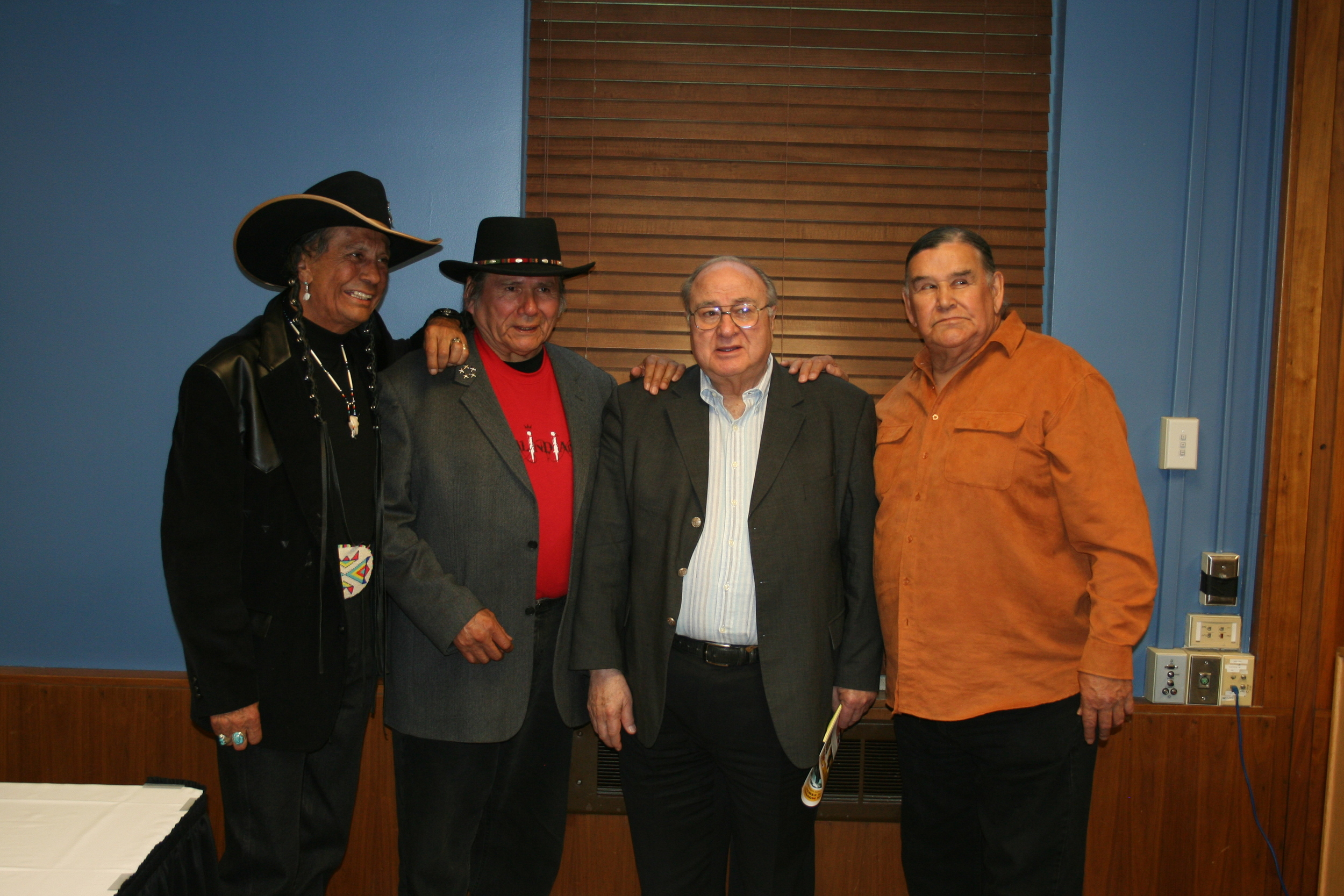 At the final session of the Dakota Conference, left to right: Russel Means, Dennis Banks, Senator James Abourezk, and Clyde Bellecourt.