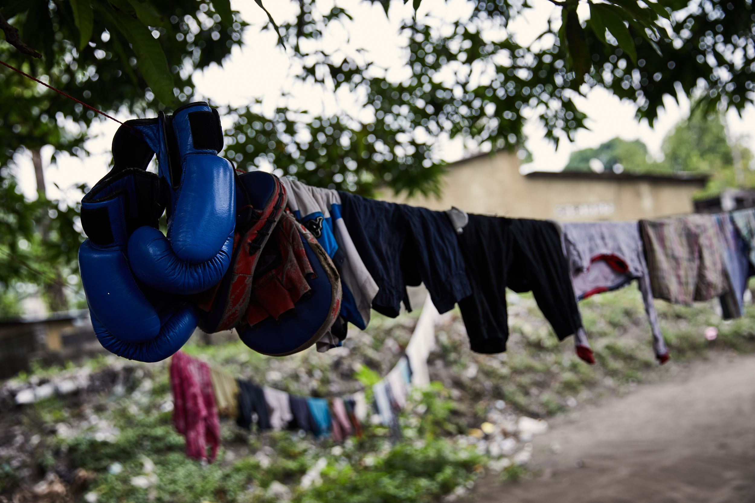 Gloves on the washing line at the home of Miki Ndaya, a boxer in Kinshasa.
