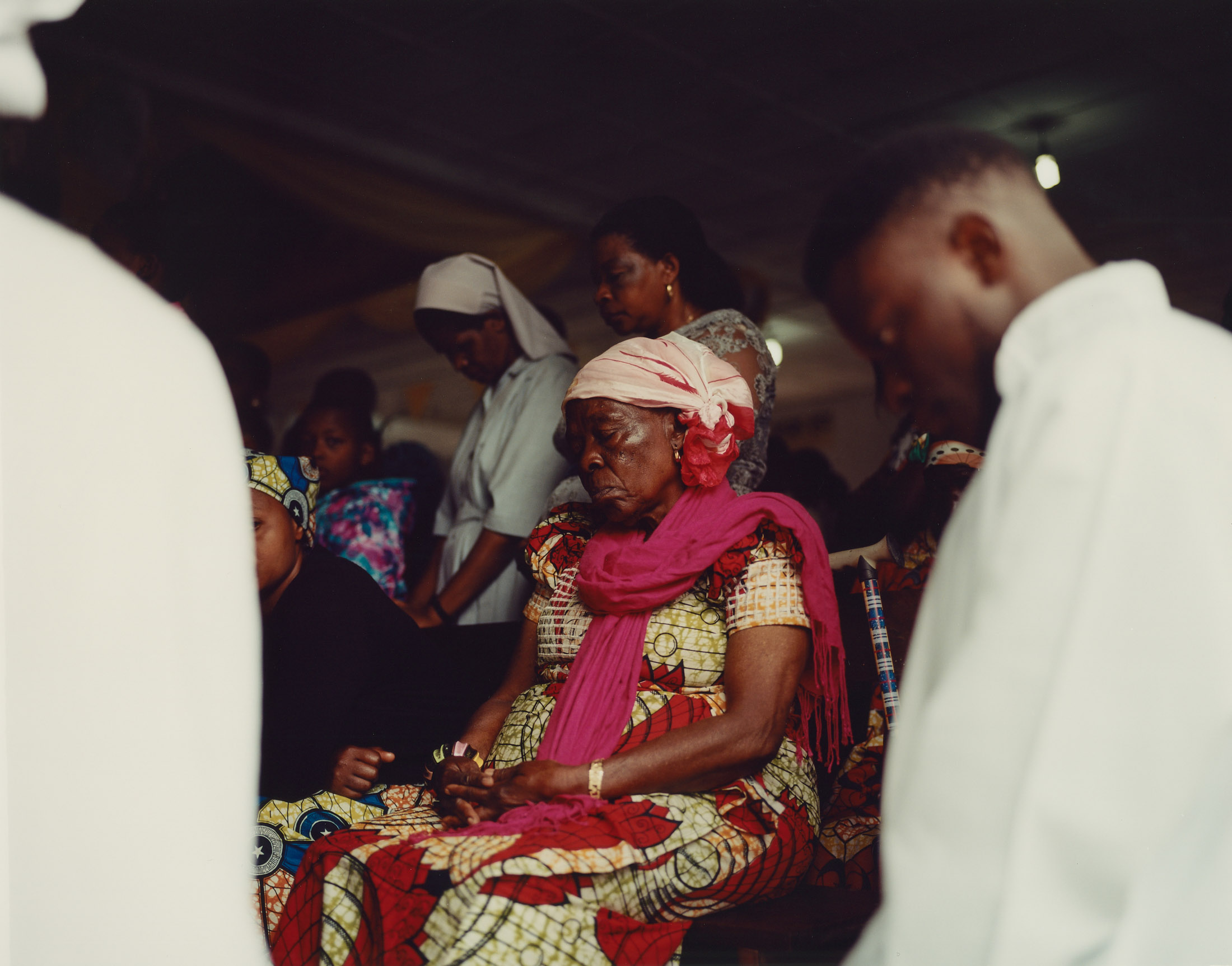 Silent prayer at the end of a Sunday service at the Anuarite de Goma church, North Kivu Province, Eastern DRC.