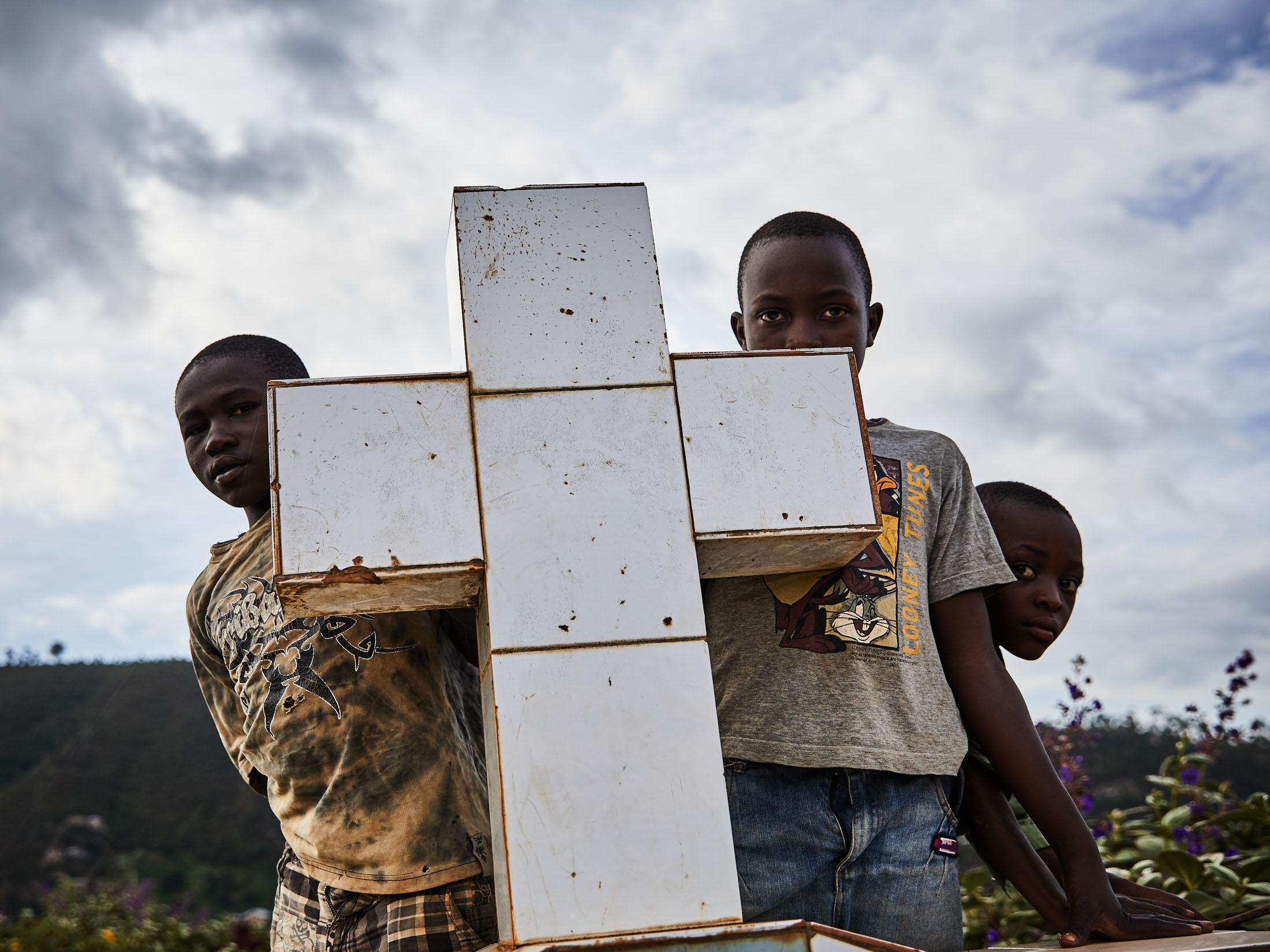 Children watch the funeral of Kavira Marie-Rose and Mumbere Mboko at Kitatumba cemetery, Butembo.