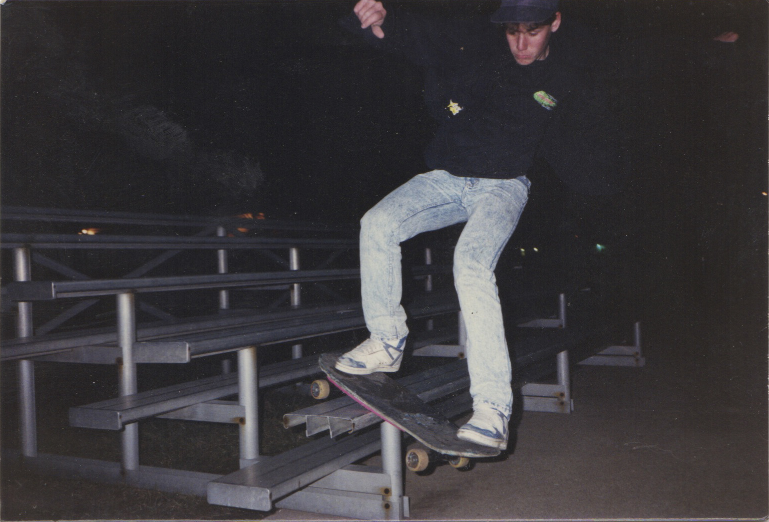 Craig Dransfield board slides the end of the bleachers at the Athens swimming pool.  Photo Courtesy of Craig Dransfield.
