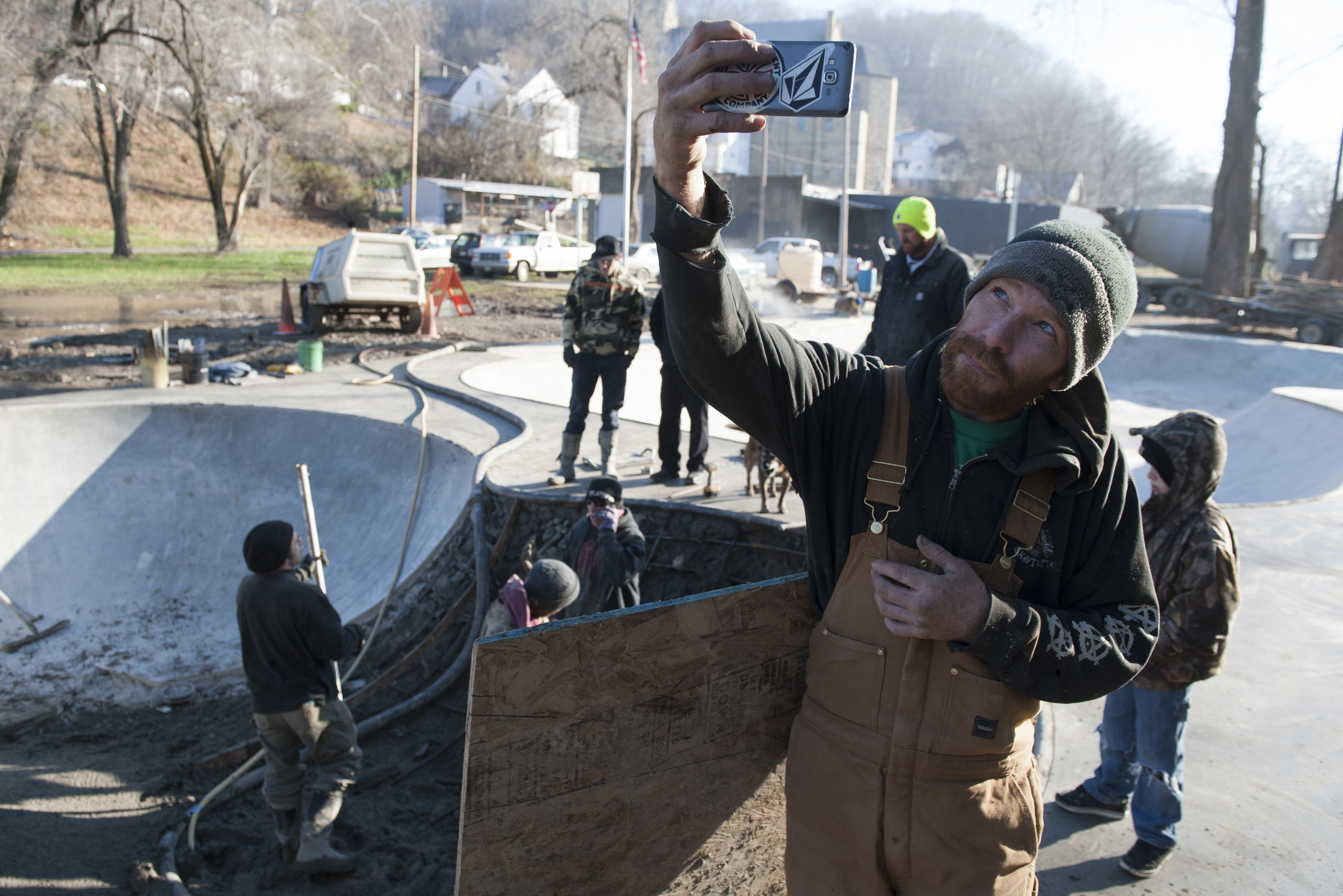 James from Skatopia takes a picture of the park and the workers while he takes a small break.