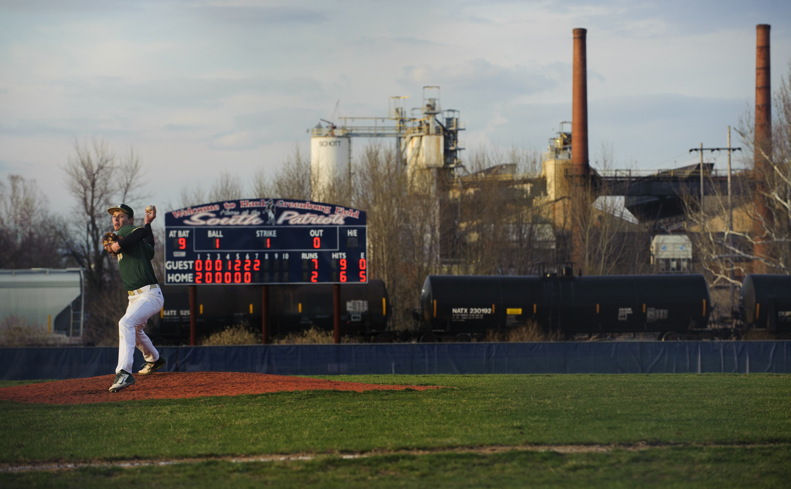 """Coal mines and power plants are a common landscape for West Virginia. In this game against Parkersburg South, Adam Luehrman pitched all seven innings, which isn't too common in high school baseball. After the game, Coach Stewart gave the game ball to Luehrman and asked him, """"When was the last time you pitched a whole game?"""" Adam responded saying, """"I'm not sure but probably eighth grade."""""""