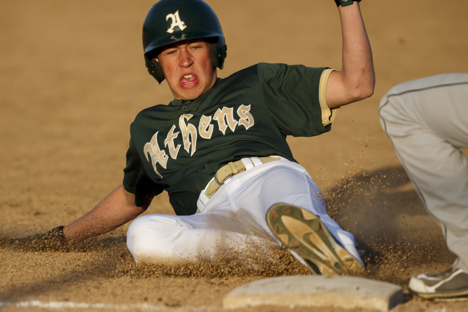 Jake Howman is called safe as he slides into third base against Parkersburg South.