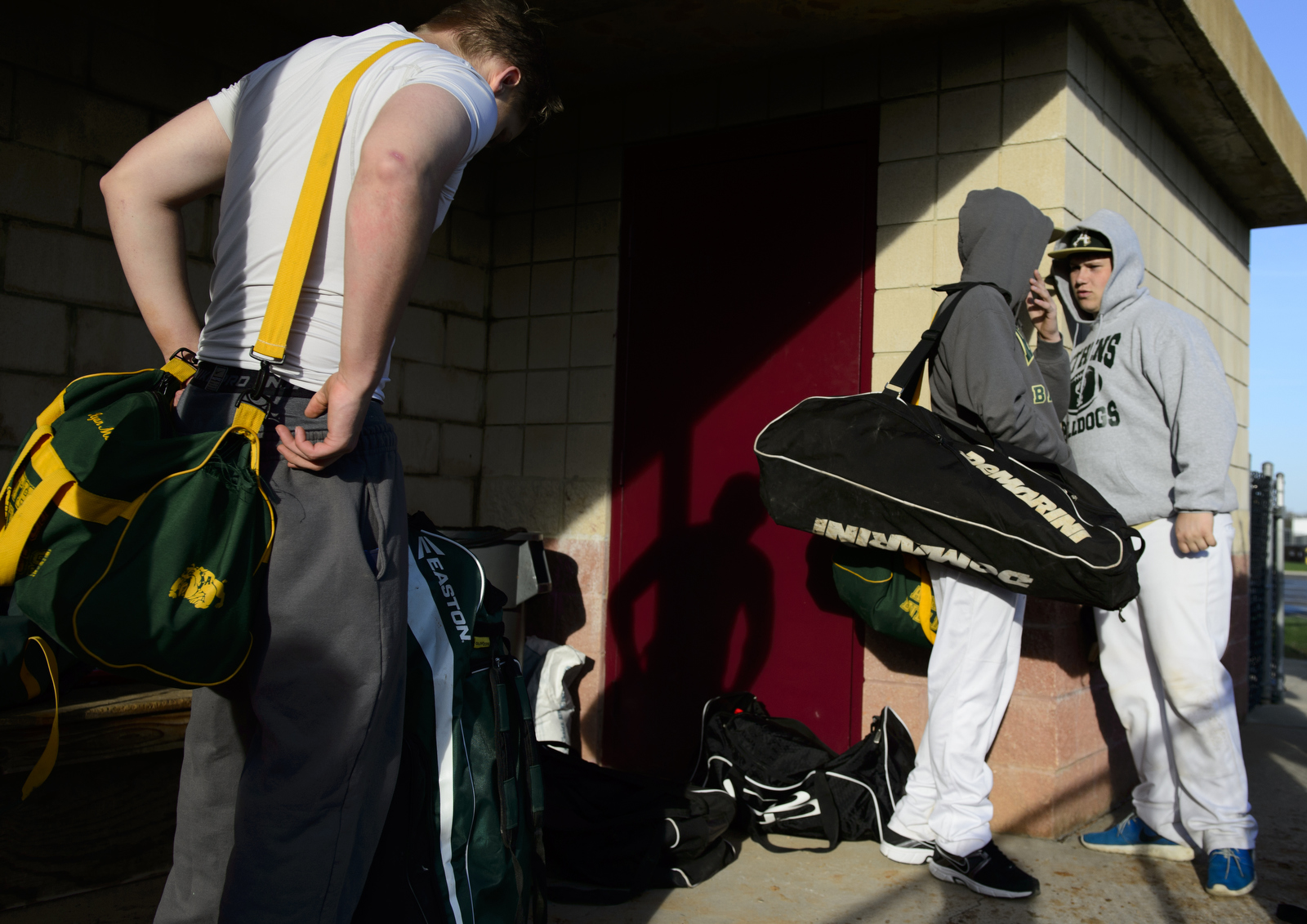 After the win against Vinton County, Ryan Mack slings his bag over his shoulder while Nathan Rickey and Kolby Rogers have a conversation before getting on the bus.
