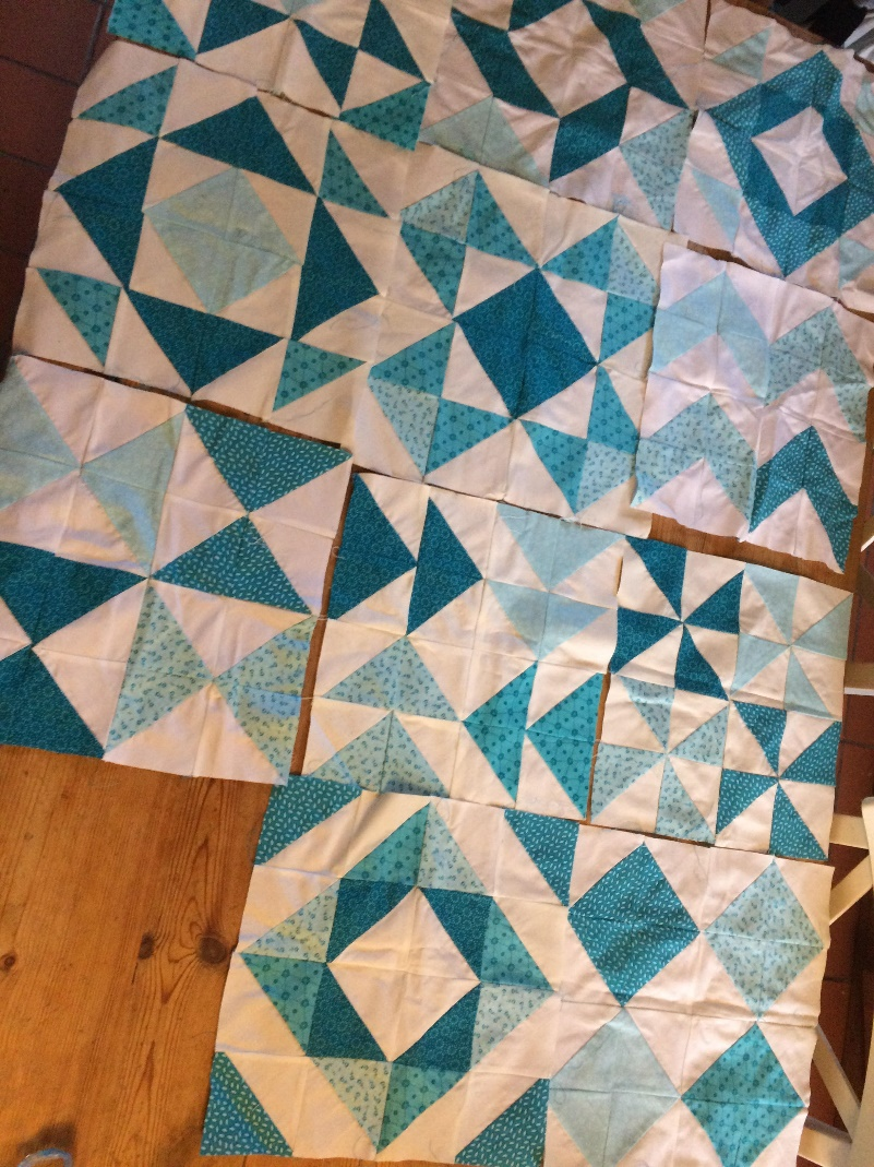 The nearly finished patchwork quilt