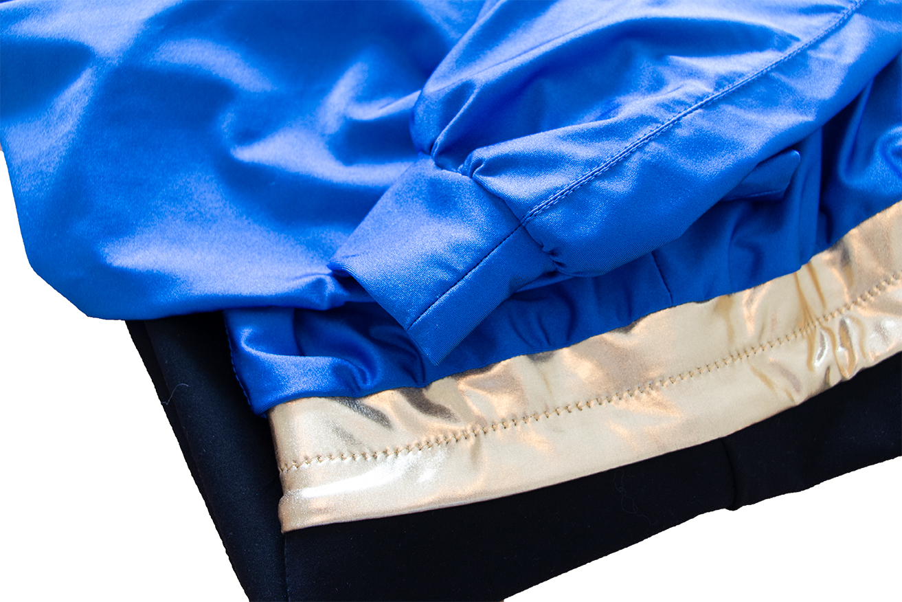 Pant seam serged with double needle sewn on top. Top seams are zig-zaged with a double need ran on top. Gold thread zig-zag on belt holds elastic support. Gathered spandex into cuff, which is double folded and serged for the finish.
