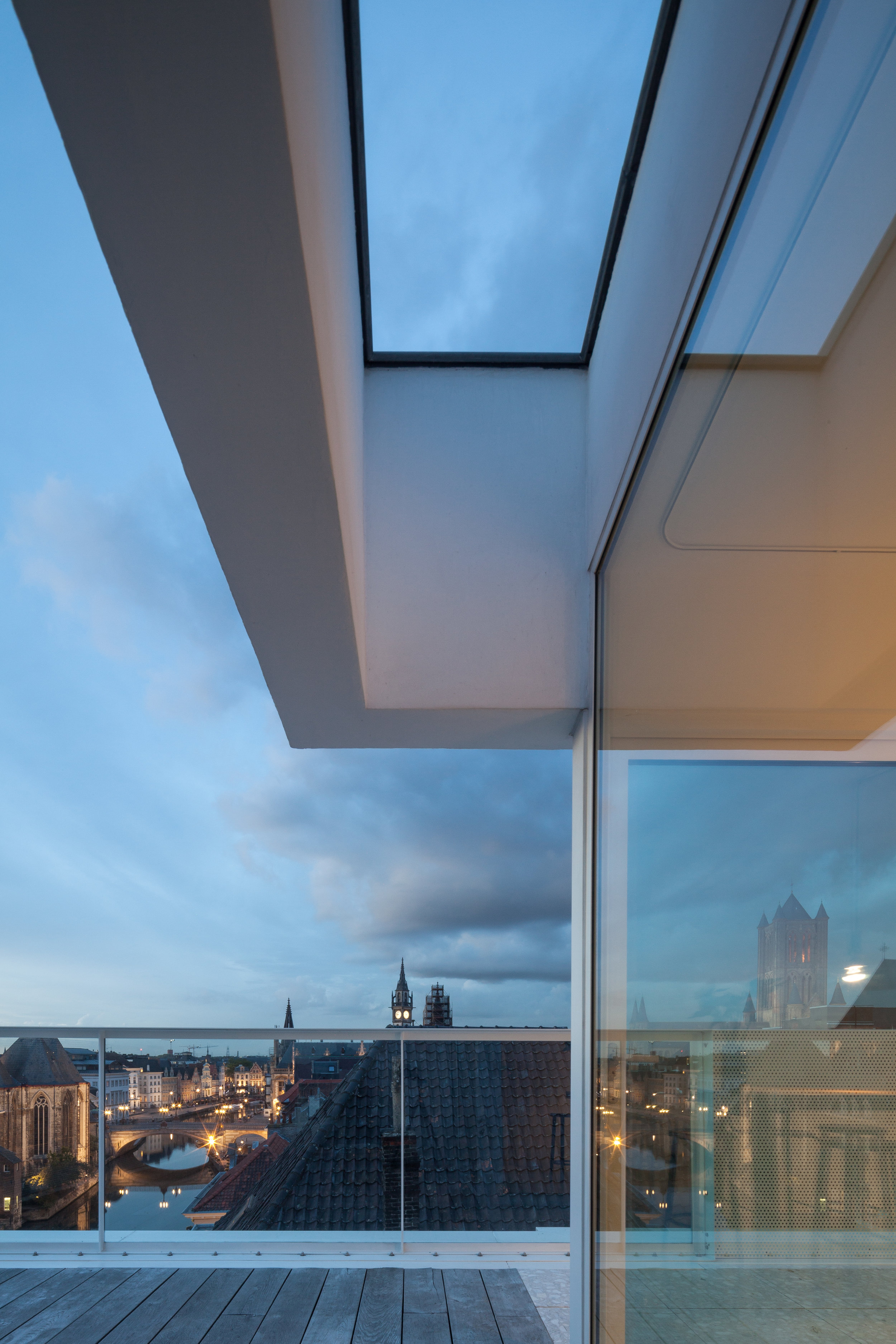 Penthouse MC , Gent Belgium  Rooftop extension and renovation of a fifties apartment block in the historic city center.  The penthouse seemingly floats in a sea of rooftops, playing with refrences to the modernist ship style. Views are created towards the various anchor points.