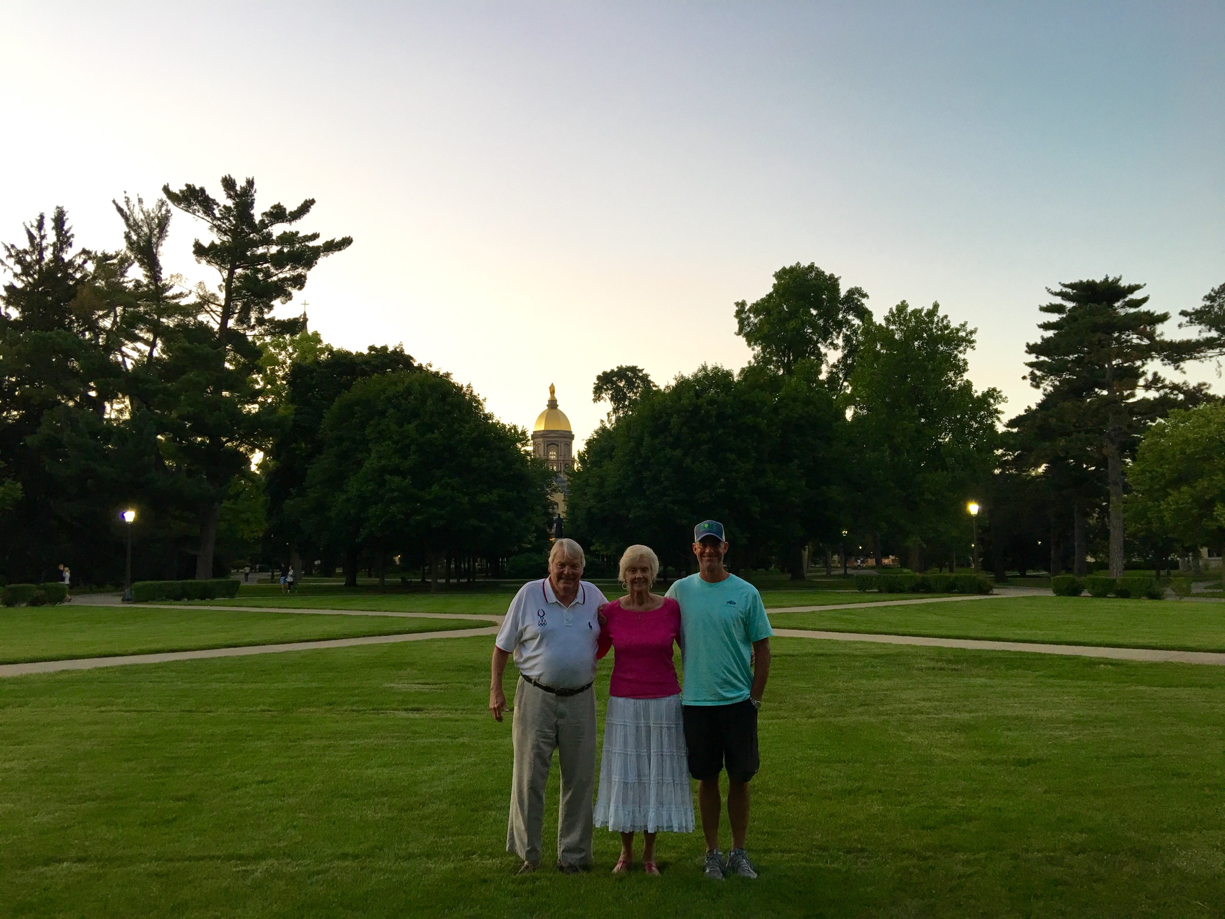 Pursuit Legend Bo Huggins strikes a pose with his mother and Barton Jahncke in front of the famous Golden Dome.