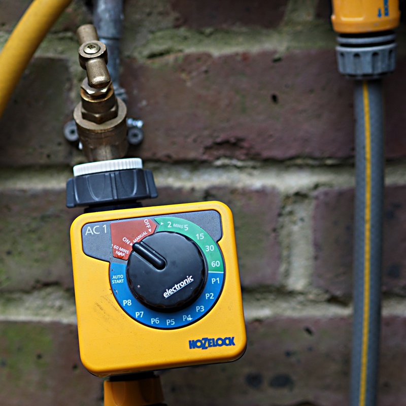 A simple timer can take care of your watering when you need to be away from your garden for a few days.