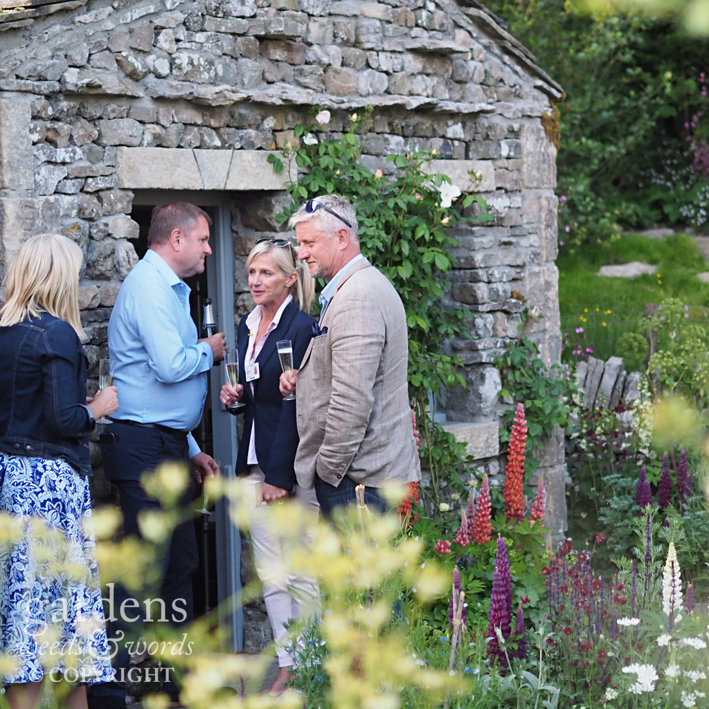 Gardens always look better with people in them . Detail from the  Welcome to Yorkshire garden from Mark Gregory , RHS Chelsea Flower Show 2018