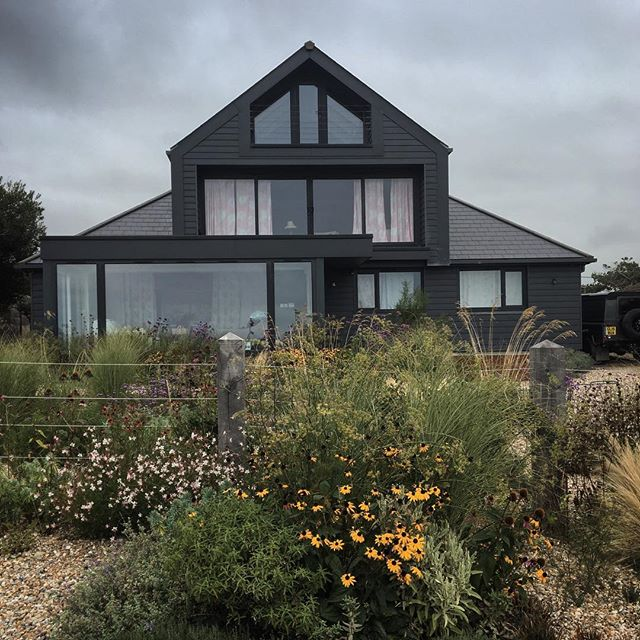 We came across a completely stunning row of houses on a cliff overlooking the channel. (Actually, if I'm honest, a little too close to the edge for our liking!) This was the most fabulous, for its well thought out design and excellently planted garden – kind of like a modern day Prospect Cottage at Dungeness, just a few miles around the bay.   No such coastal shenanigans for me today. Back to work, not in a garden, but at a gardening trade show. Which, after all is said and done, is still a trade show. And I hate trade shows. The bonus is getting to catch up with some lovely folk who work in the horticultural industry, so it will be worth the aching feet and lack of daylight.   #mystoryoflight #peninpractice #olympusuk #tostandandstare #coast