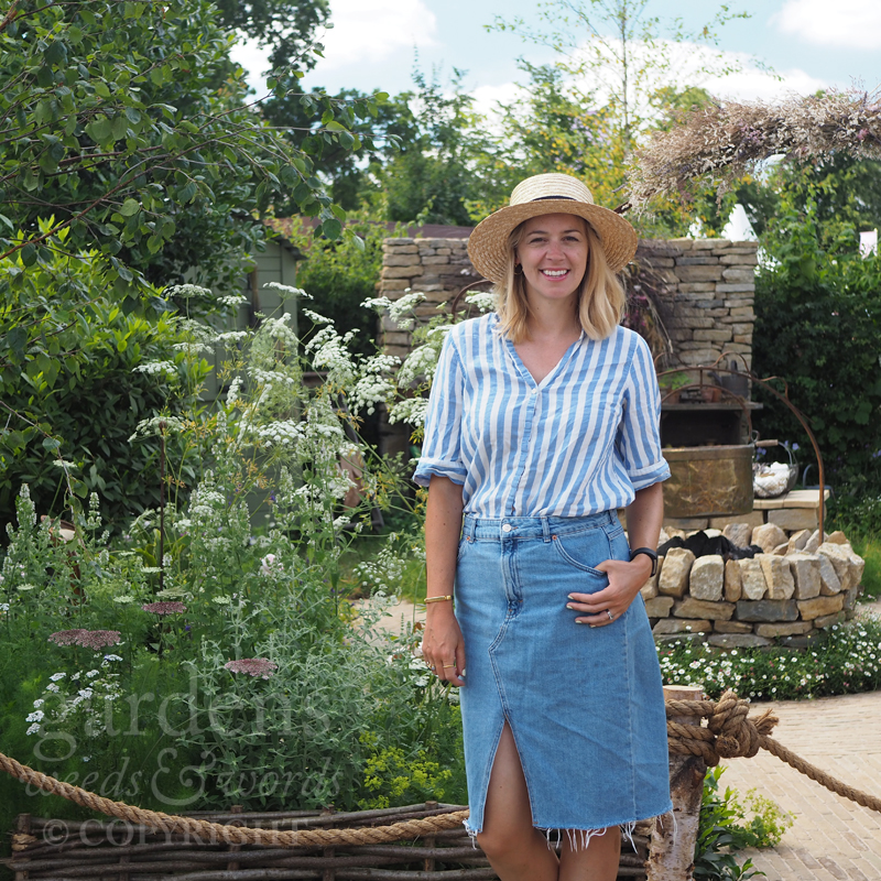 Designer  Pollyanna Wilkinson  in front of  The Naturecraft Garden  for Belvoir Fruit Farms, at the RHS Hampton Court Flower Show 2019