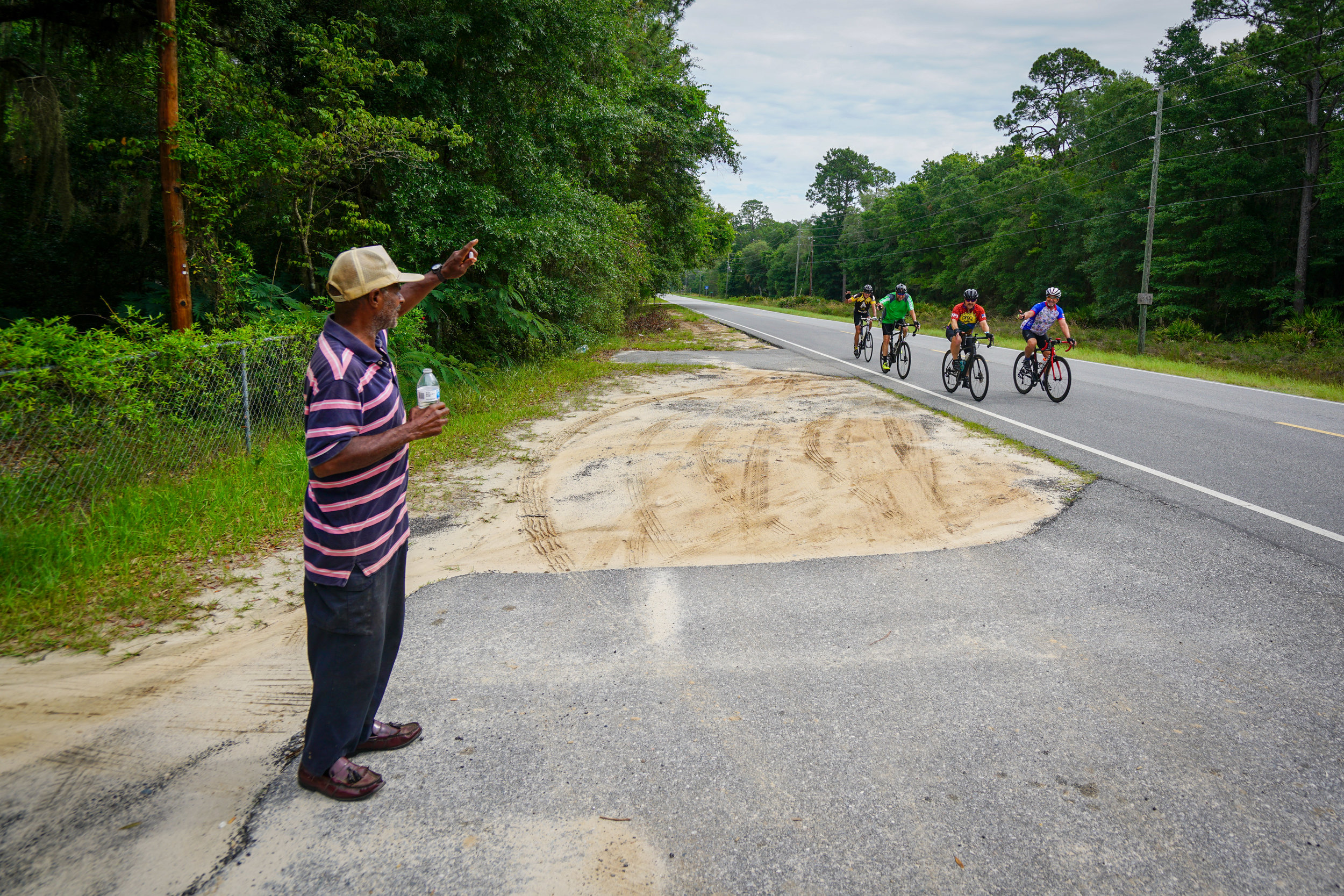 Cooper waves at cyclists as they pass his house on USBR 1 in McIntosh, GA .June 2019.  Photo: Russell Oliver