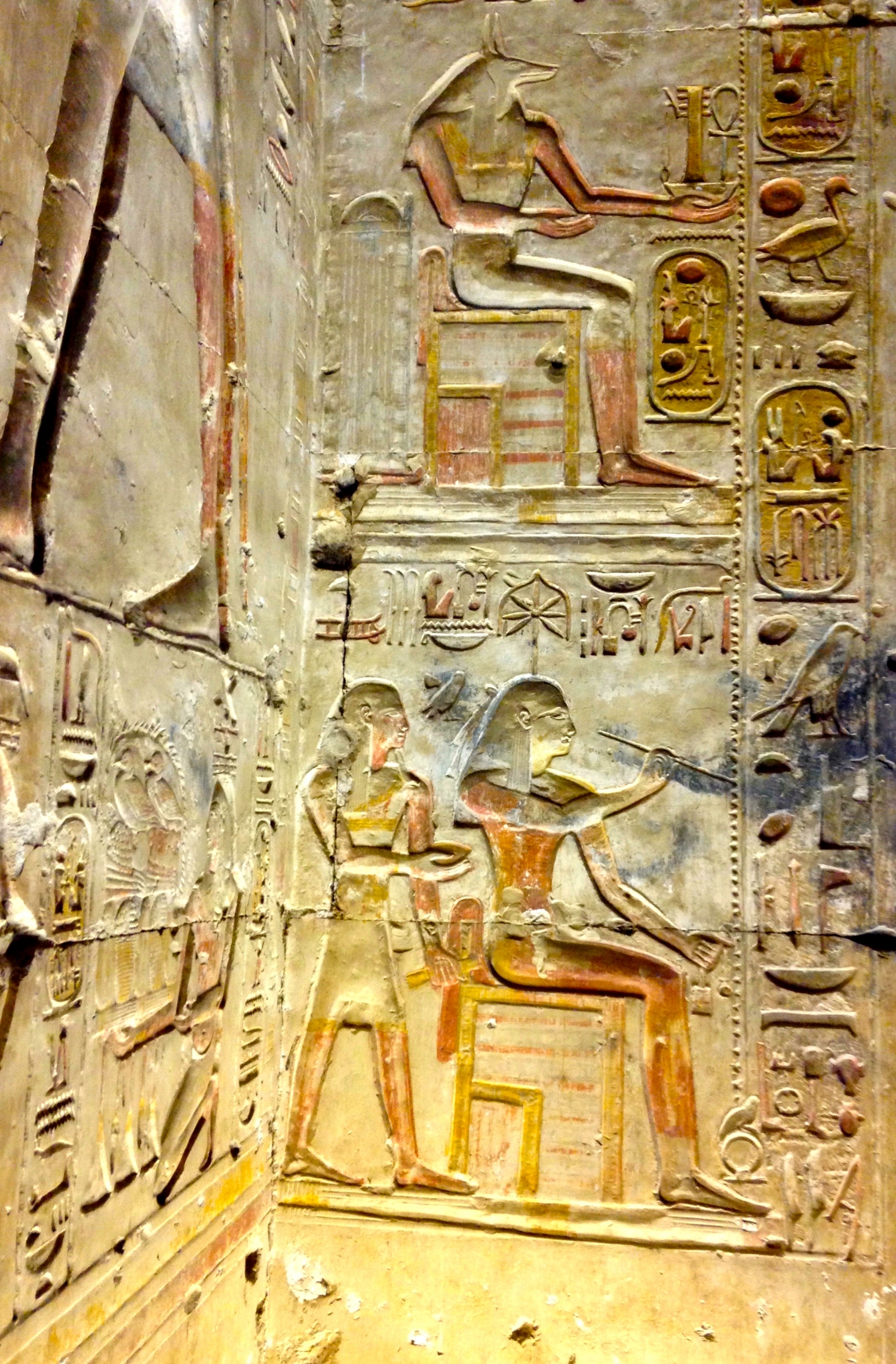 Goddess Seshat and God Anubis at left of doorway at Temple entrance