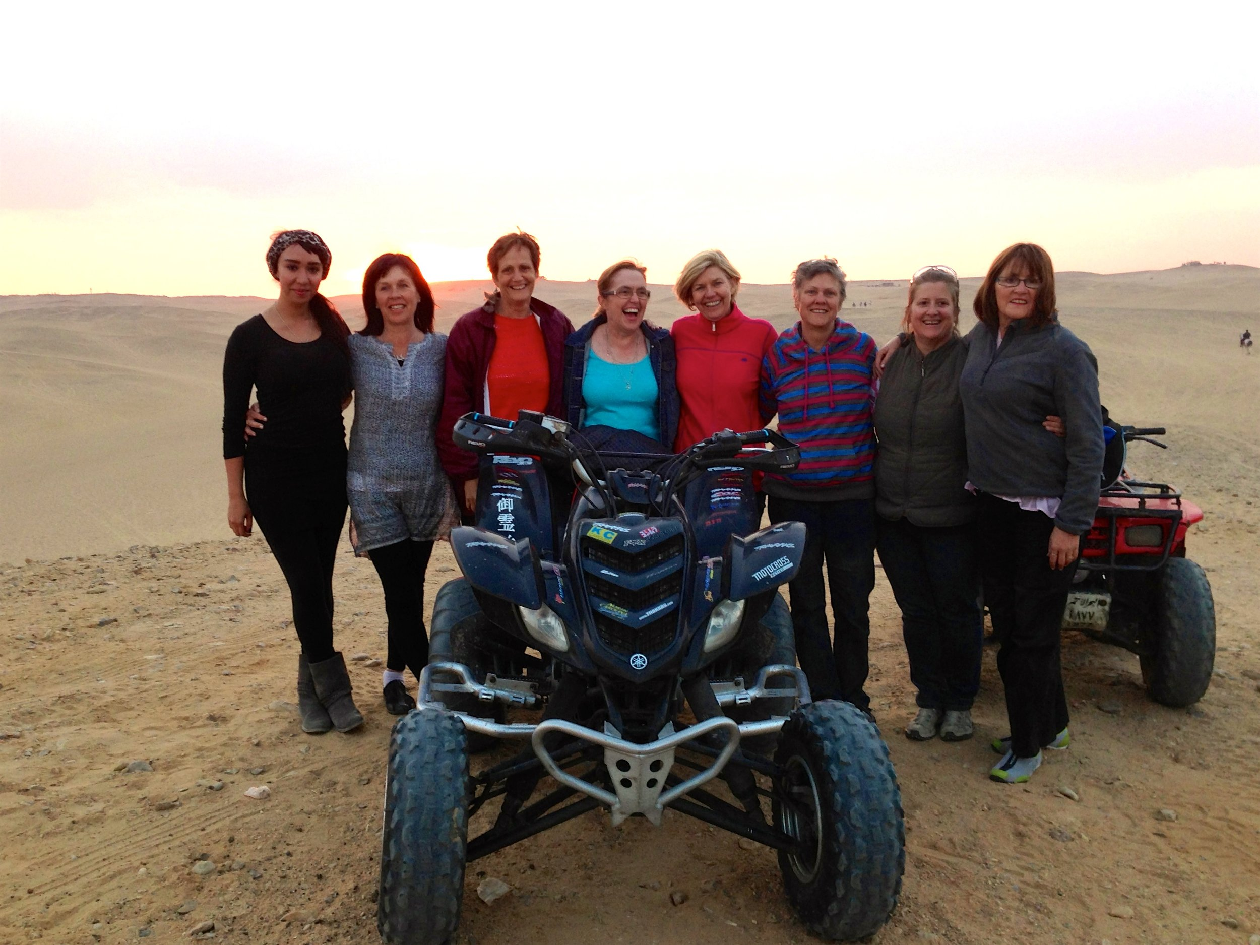 2012 Group riding quad bikes on the sand dunes at Giza Plateau