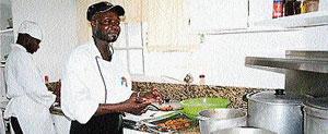 Chef 'Oliver' prepares conch fritters, a special at Villa Juanita.