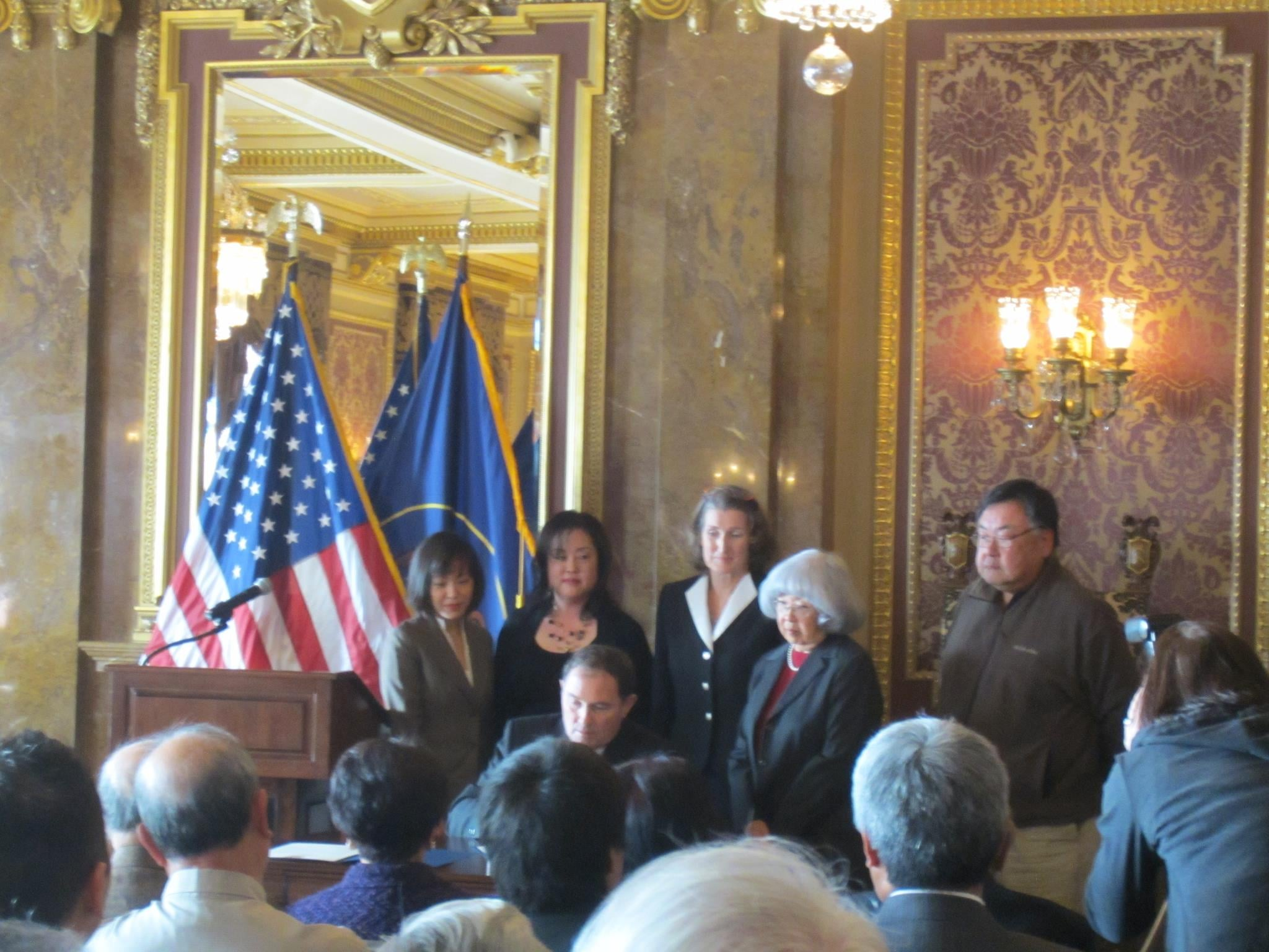 Utah Governor Gary Herbert signs the Fred Korematsu Day declaration today for January 30, 2013 as KI director Ling Woo Liu, former Salt Lake County Councilmember Jani Iwamoto, Topaz Museum board director Jane Beckwith, JACL-Salt Lake City co-president Jeanette Misaka look on.