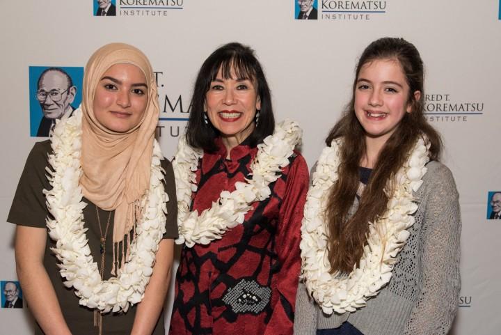 Fred T. Korematsu Middle School speech winners Madeeha Khan, left, and Vivien Wallis, right, with Karen Korematsu.