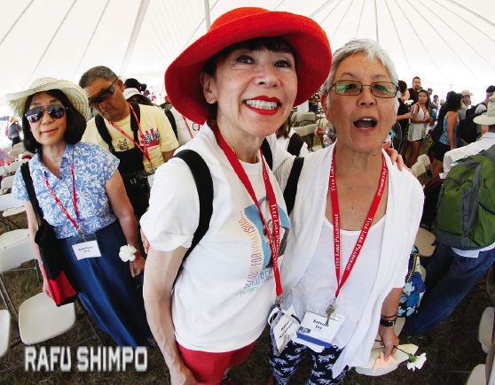 """[Karen Korematsu, daughter of Fred Korematsu, and filmmaker Dr. Satsuki Ina (""""Children of the Camps"""") take a moment to say hello and pose for a picture at the end of the Tule Lake memorial service. (MARIO G. REYES/Rafu Shimpo)]"""