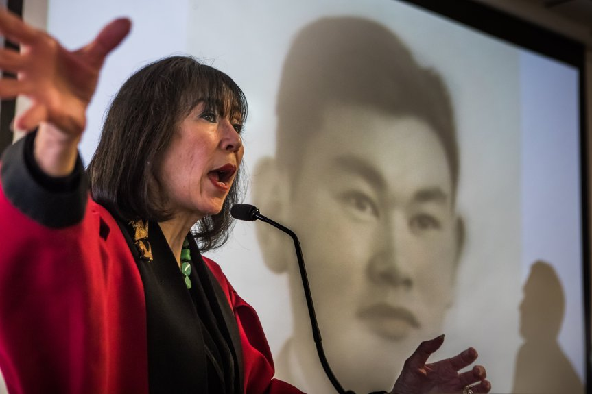 Karen Korematsu speaks to a crowd of about 100 about her father, Fred Korematsu and his struggle against the World War II-era racial profiling of Japanese American citizens and Japanese immigrants. His image is projected in background. The event was held at the Muslim community center the Pacifica Institute in Albany and featured a multicultural gathering of members of Jewish and Muslim groups in the Bay Area. Photo by Paul Kuroda