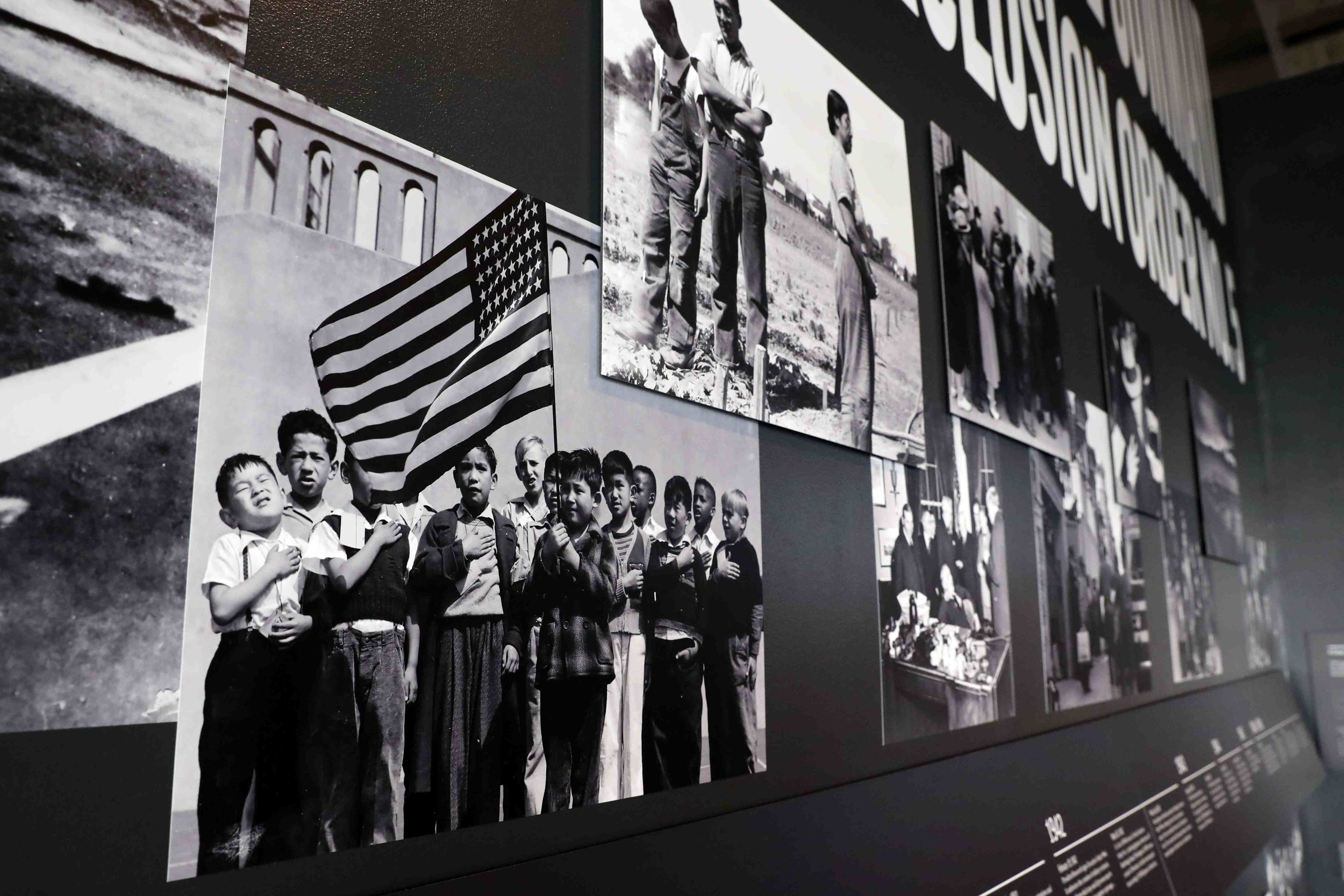 """Pre- and post-war photographs adorn a wall of the """"Exclusion"""" exhibit in the Presidio Officers' Club in San Francisco.  Photo by Darren Yamashita"""