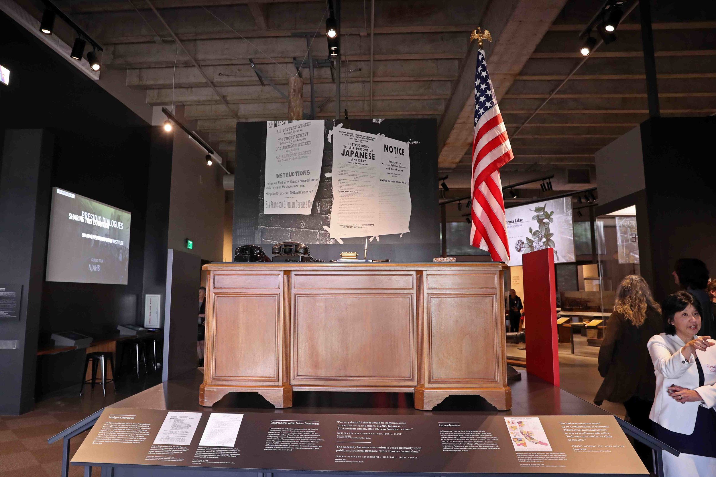 """A 1940s-era desk, a representation of the orders that were signed at the Presidio by Lt. Gen. John DeWitt to send Japanese Americans to the camps, sits in the center of the """"Exclusion"""" exhibit.  Photo by Darren Yamashita"""
