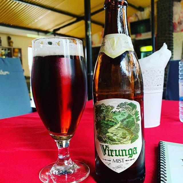 Getting close, and after an hour+ walk I earned this! #gorillasinthemist #gorillas #rwanda #ruhengeri #virunga #virungabeer #beer