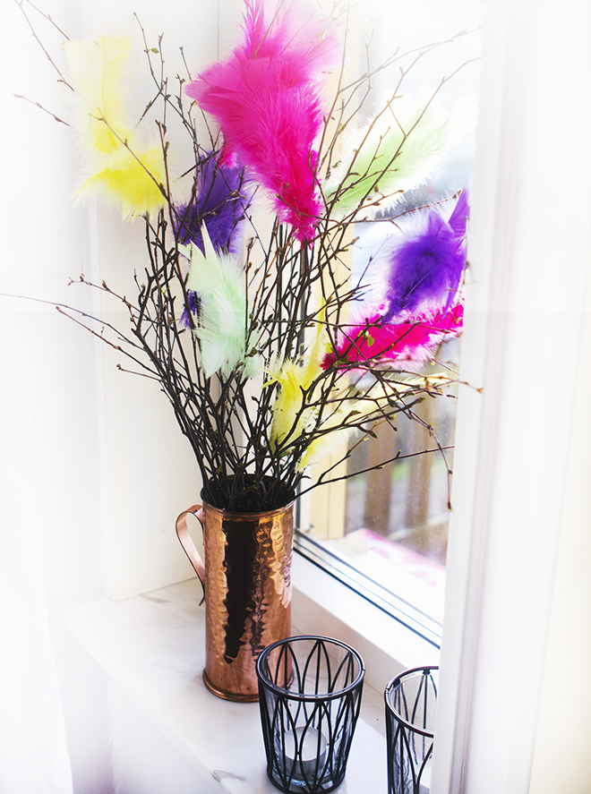 A Swedish tradition is to decorate twigs with feathers. We love this bright combination and stylish copper vase. photo courtesy by  Tinkerbella.