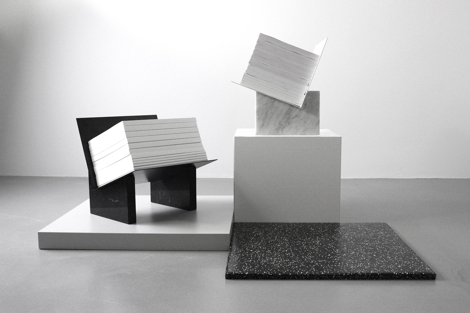 MONUMENTS - this bold design turns a mundane magazine holder into a really dramatic piece. Made with marble and bended metal sheets for a striking architectural feel.